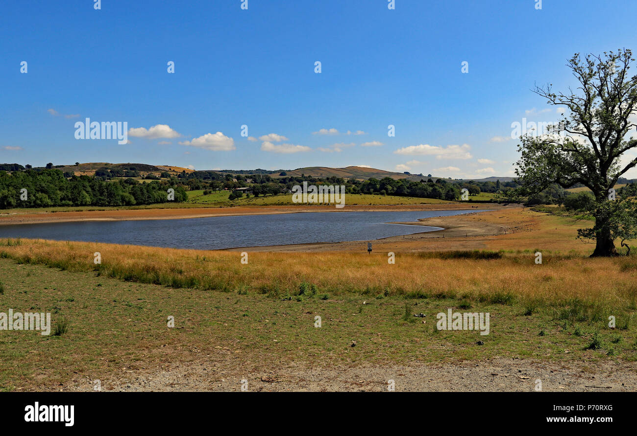 Foulridge upper reservoir on Tuesday 3.7.18 showing the low water levels which has resulted in navigation restrictions being applied to the canal. - Stock Image