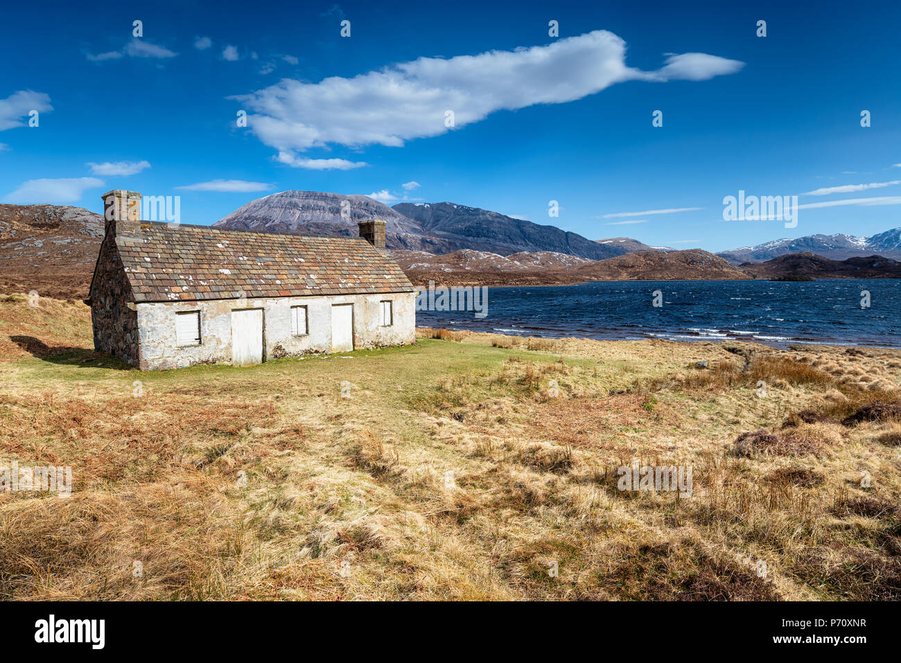 An abandoned cottage on the shores of Loch Stack in Scotland - Stock Image