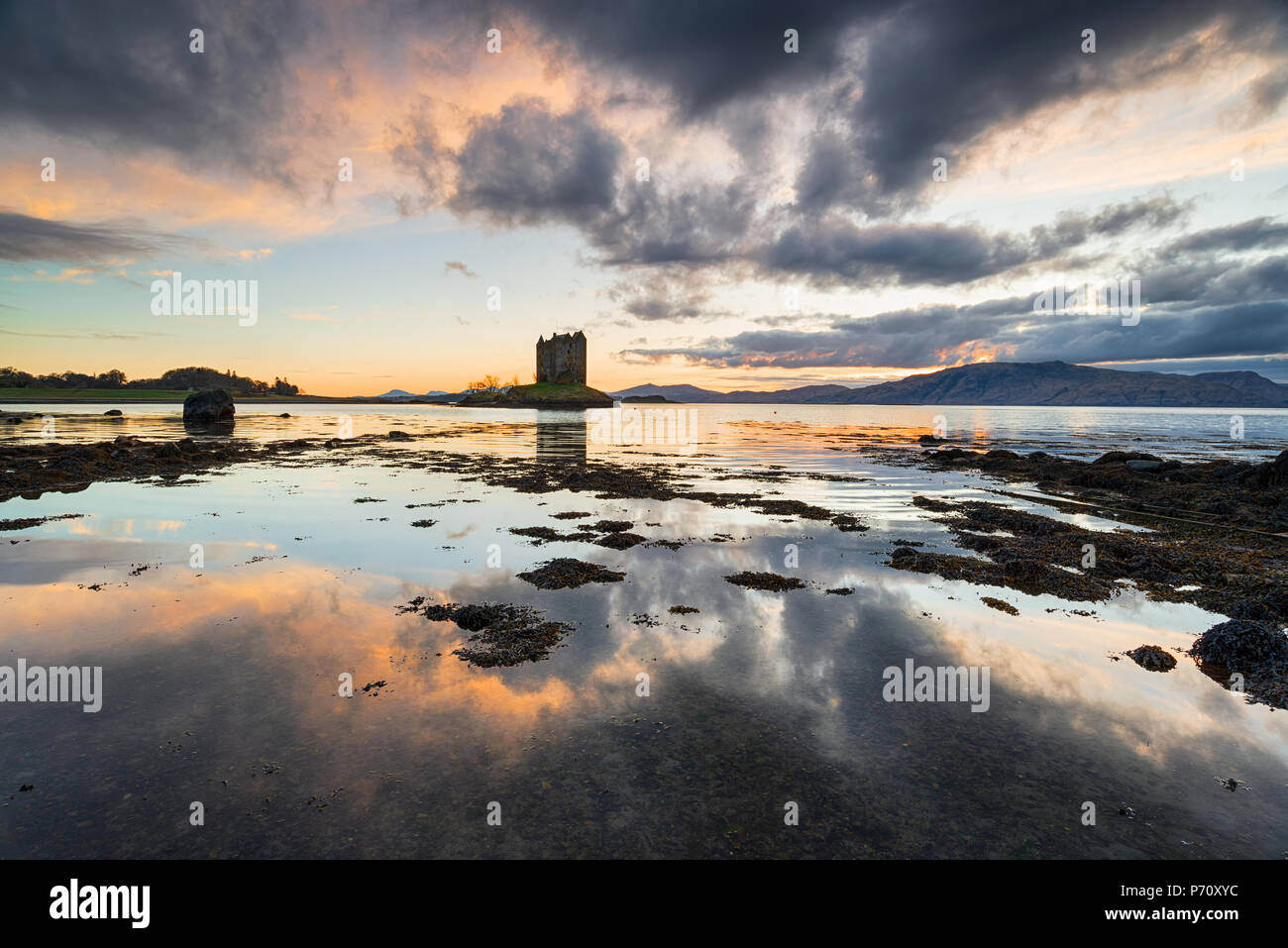 Dramatic sunset over Castle Stalker on Loch Linnhe in Scotland Stock Photo
