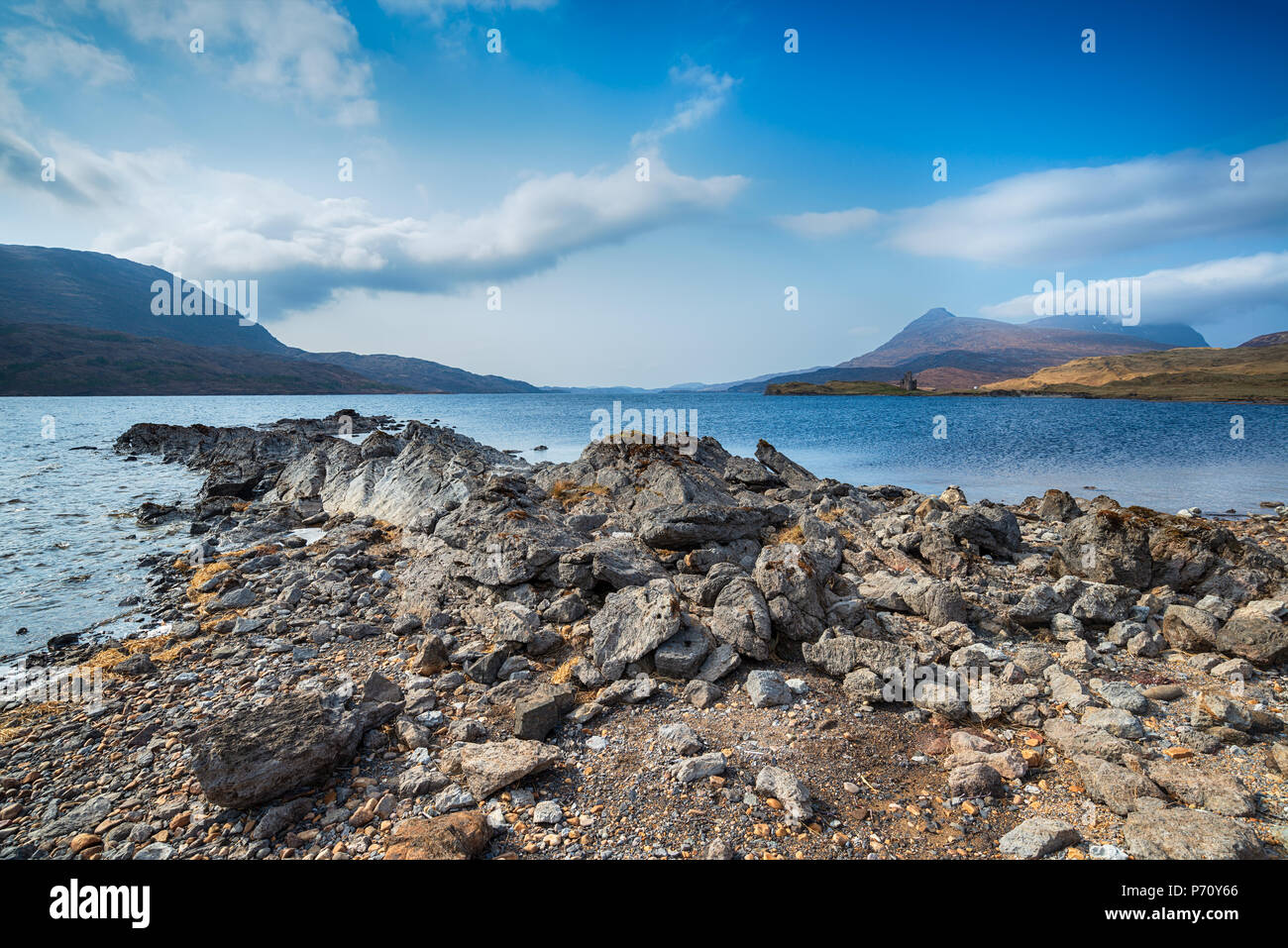Loch Assynt with Ardvreck Castle in the far distance - Stock Image
