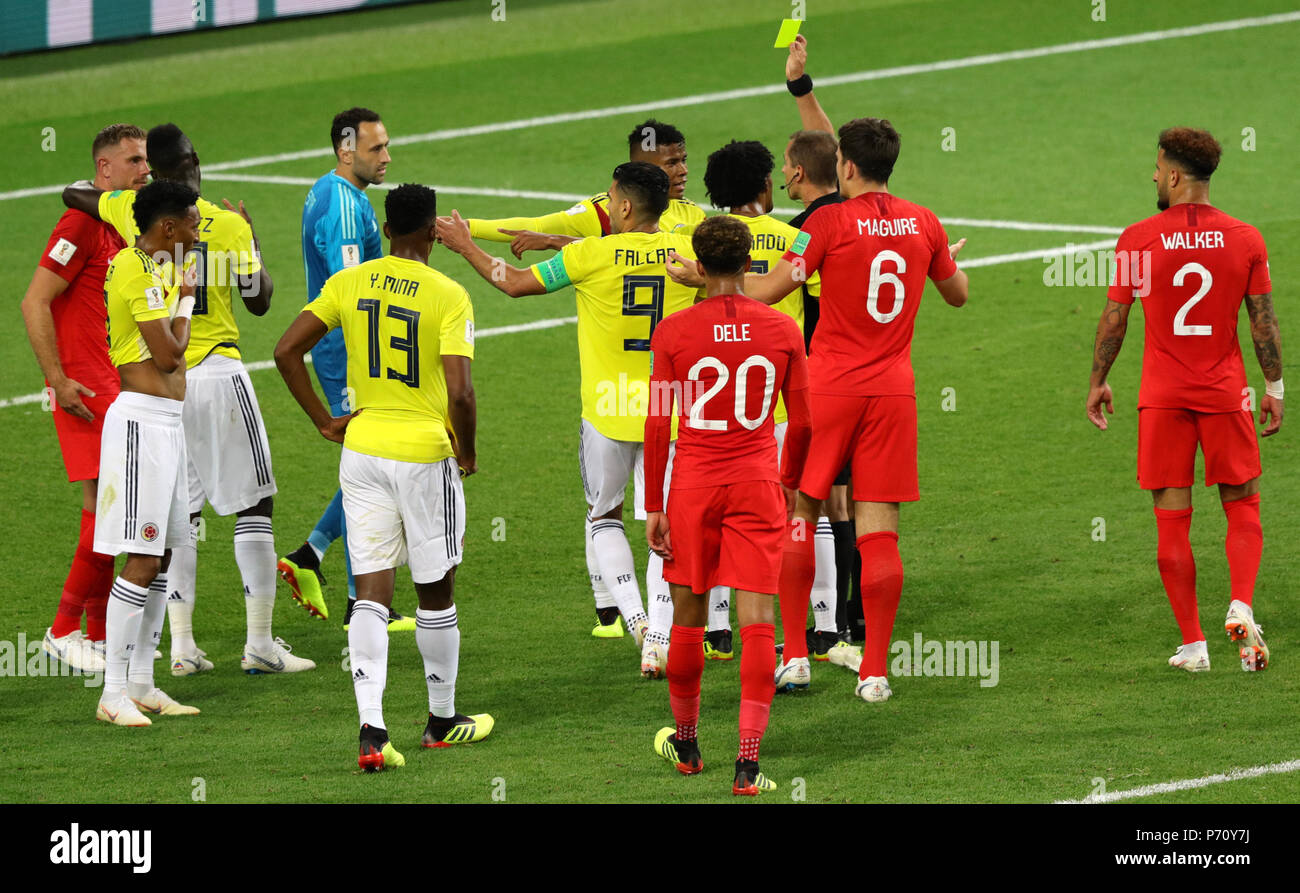 06e175fbe Match referee Mark Geiger shows Colombia s Wilmar Barrios a yellow card for  head butting England s Jordan