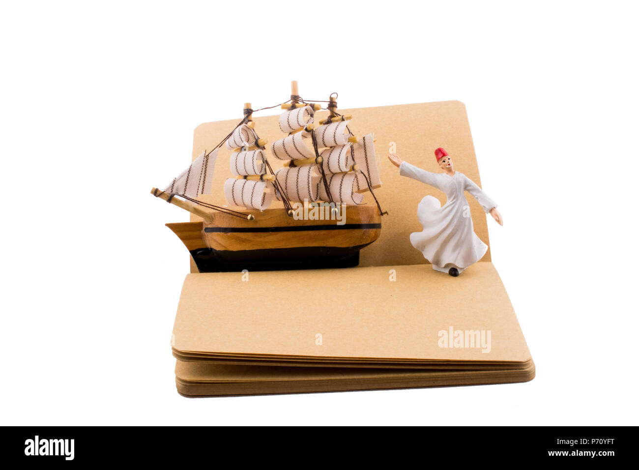Sufi Dervish and a ship on a notebook on white background - Stock Image