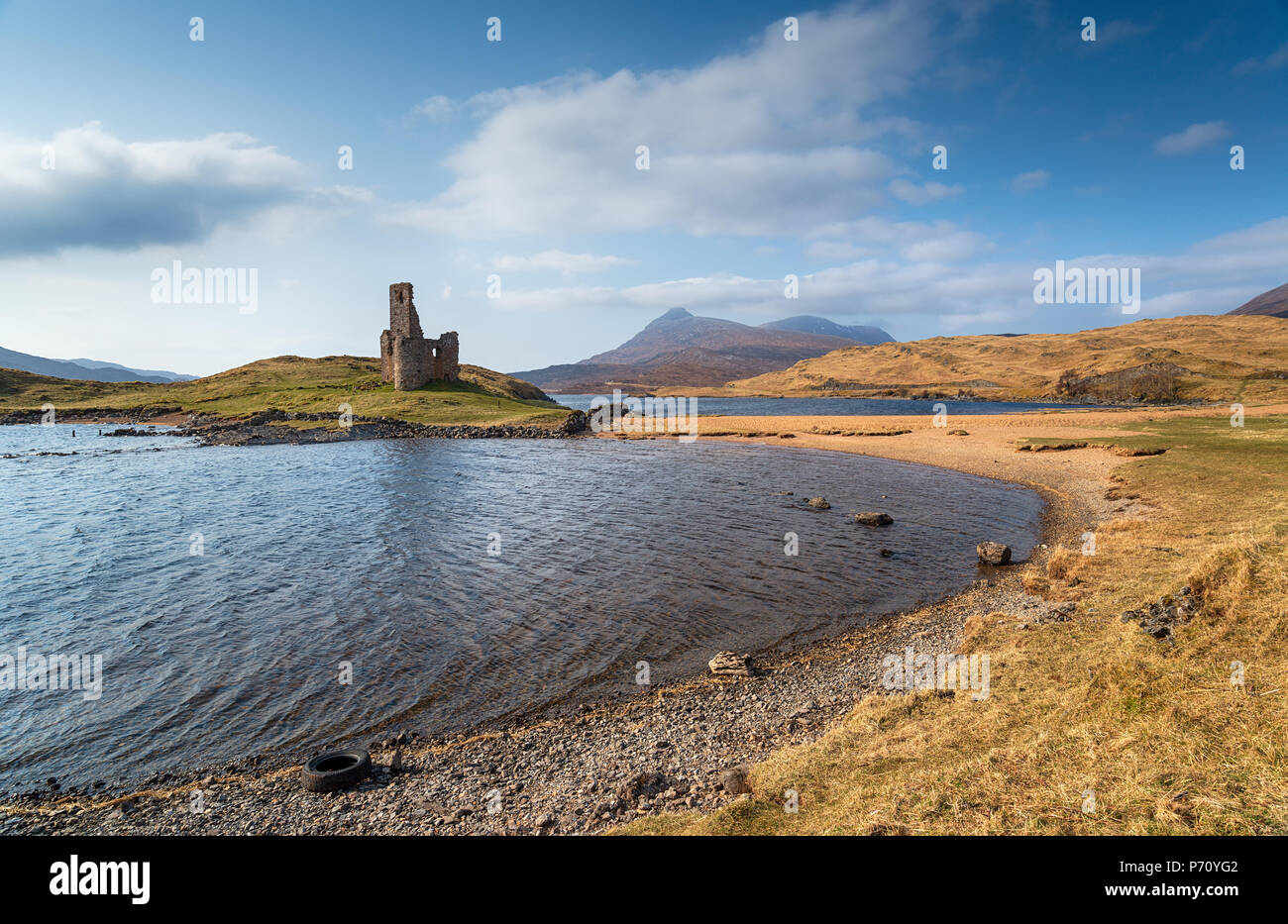 The ruins of Ardvreck Castle on Loch Assynt in Scotland - Stock Image
