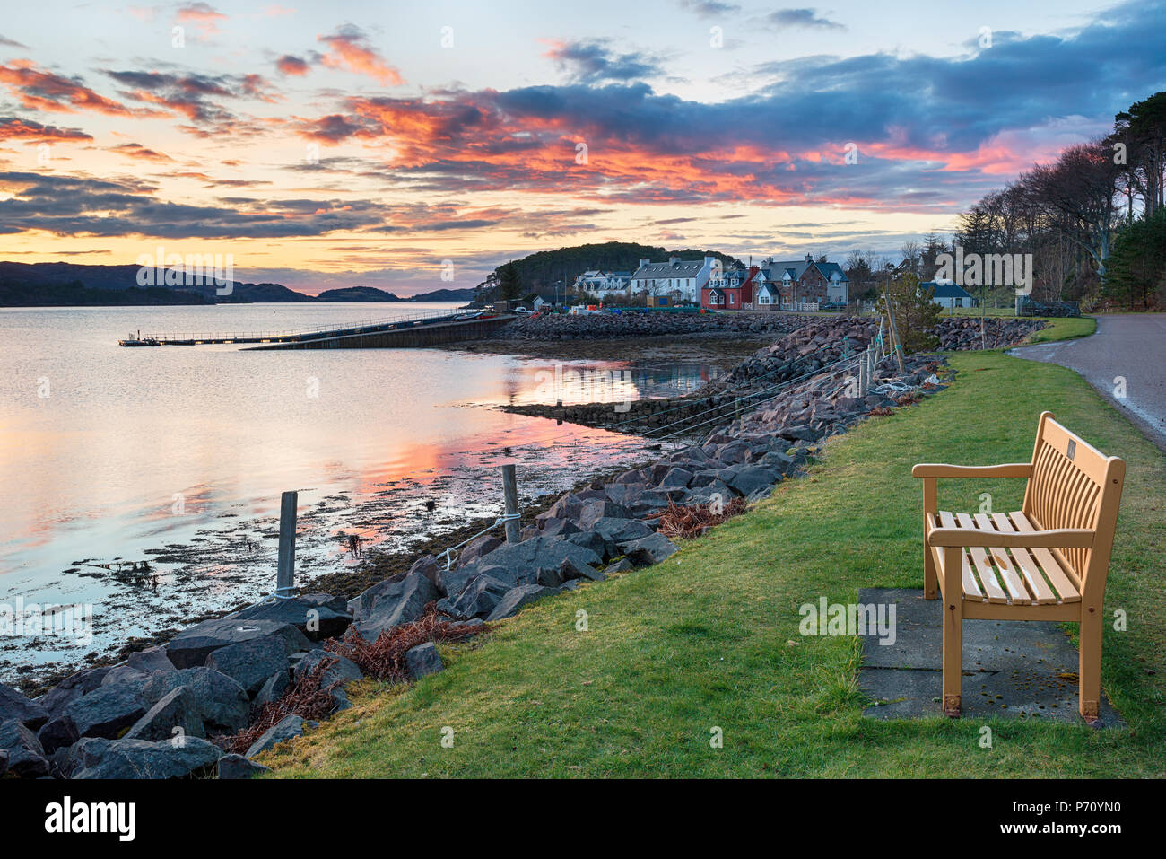 Stunning sunset over the fishing village of Shieldaig near Applecross on the NC500 tourist route in Scotland - Stock Image