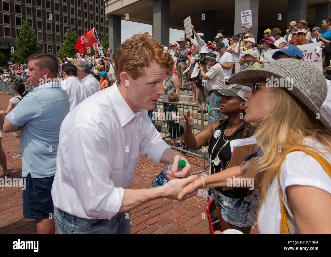 U.S. Democratic Representative Joseph Patrick Kennedy III (Joe Kennedy), grandson of Robert Kennedy and grand-nephew of John F. Kennedy Shaking hands at Boston City Hall during the Rally against Family Separation in Boston, MA. Kennedy had spoken against U.S. President Donald Trump's policy of detaining immigrants and separating immigrant families.  Large rallies against President Trump's policy of separating immigrant families took place in more than 750 U.S. cities on June 30th of 2018. Stock Photo