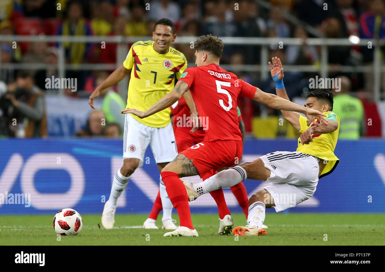 436e3a08b16 England s John Stones (centre) battles for the ball with Colombia s Radamel  Falcao (right