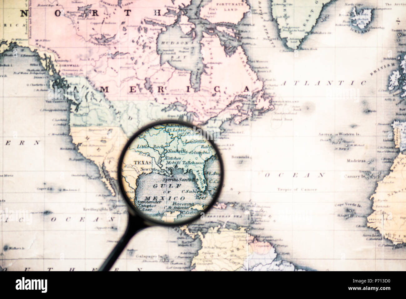 top view of magnifying glass on world map over gulf mexico ...