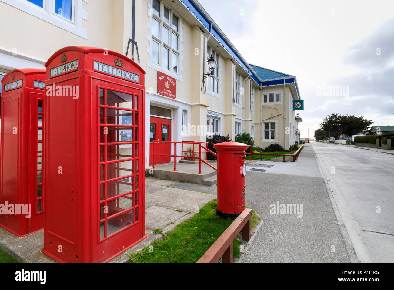 Post Office, Philatelic Bureau, red telephone boxes and post box, Central Stanley, Port Stanley, Falkland Islands, South America - Stock Image