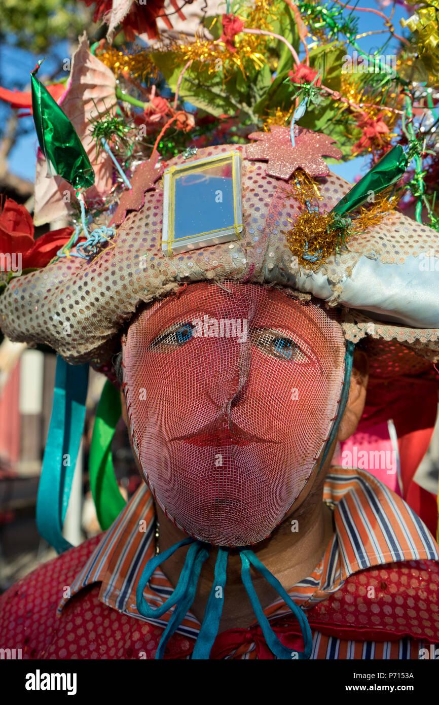 Masked reveller at carnival parade in Granada, Nicaragua, Central America - Stock Image