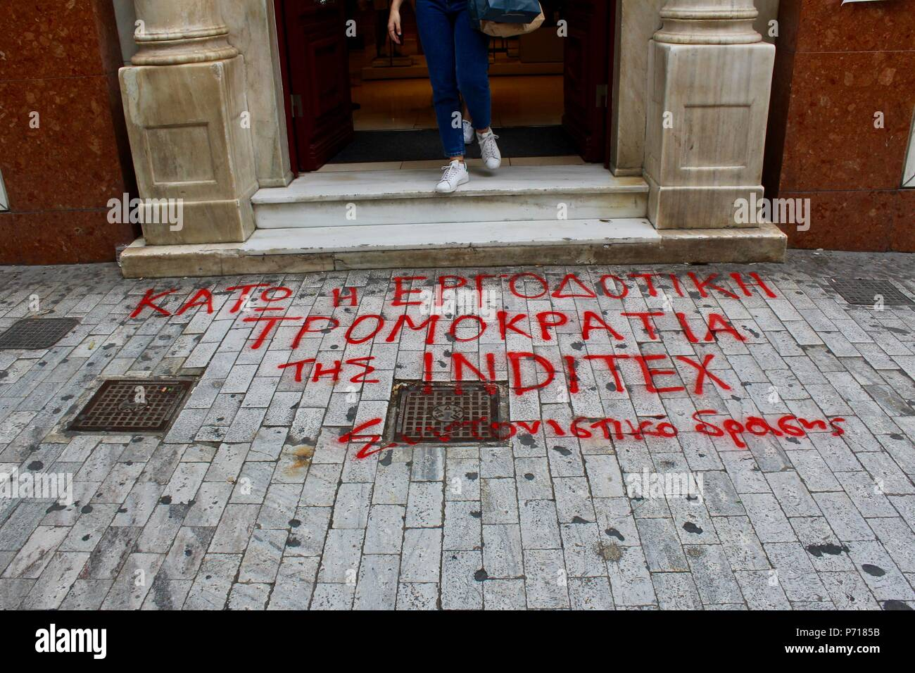 anti sunday trading graffiti outside athens store greece - Stock Image