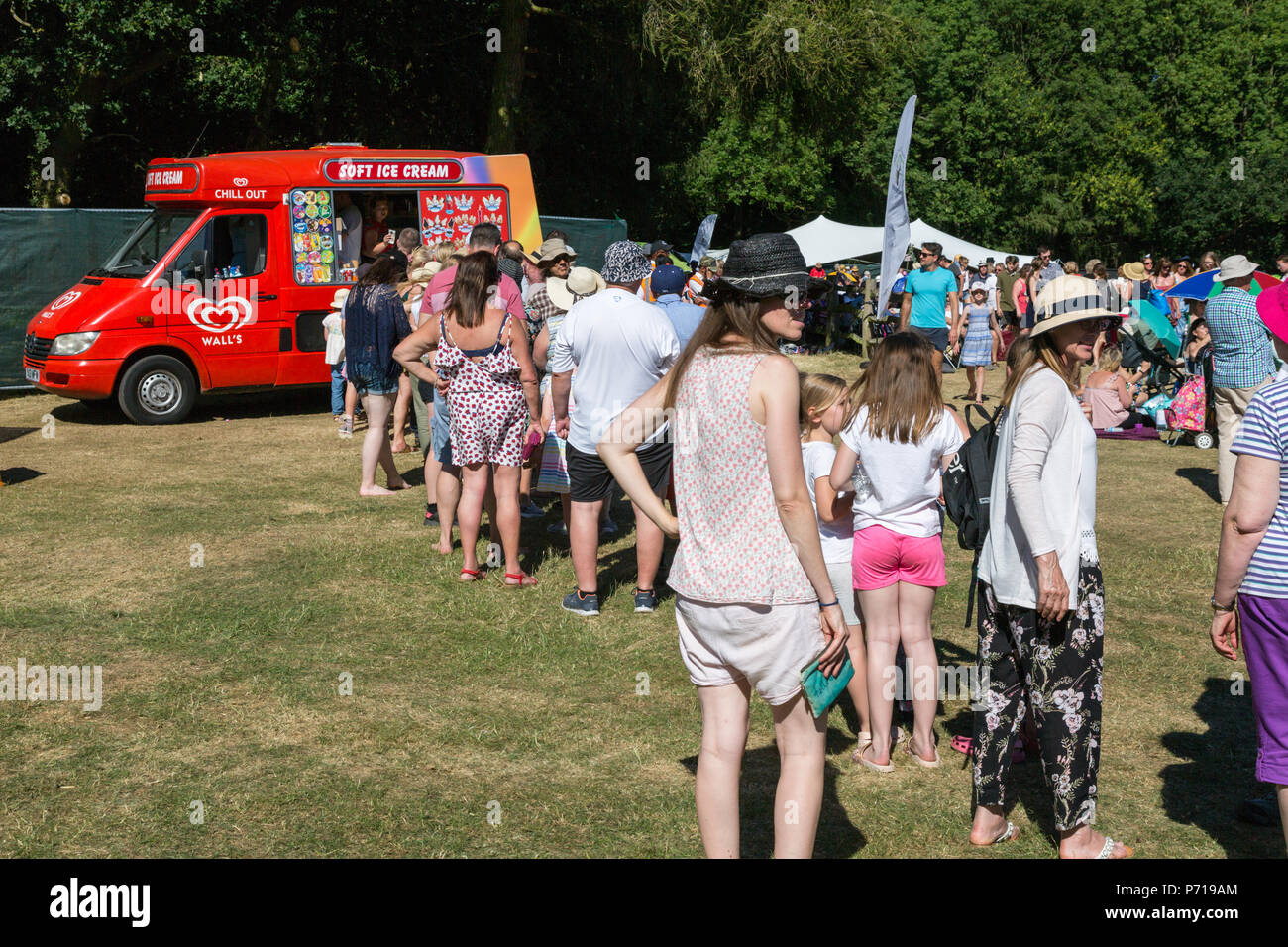 People queuing for ice cream in a park, Birmingham UK - Stock Image