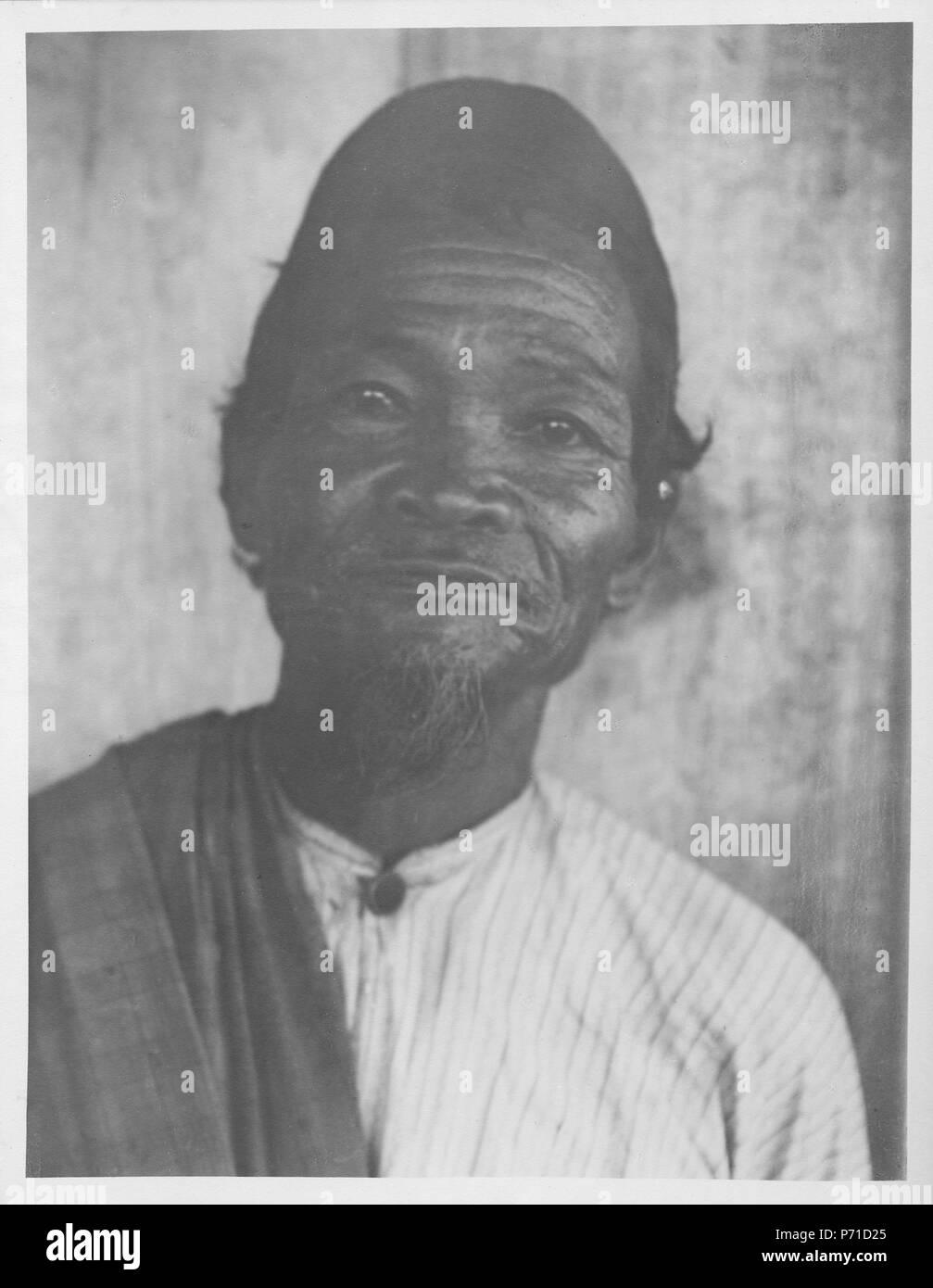 14 Gammal man från Togid, Boolang-Mongondou. Kabupaten Bolaang Mongondow, Sulawesi. Indonesien - SMVK - 000173 - Stock Image