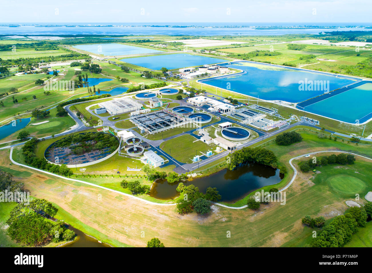Modern lagoon waste water style sewage treatment plant in Bradenton Florida fl where normal household sewage is treated and filtered and recycled for  - Stock Image