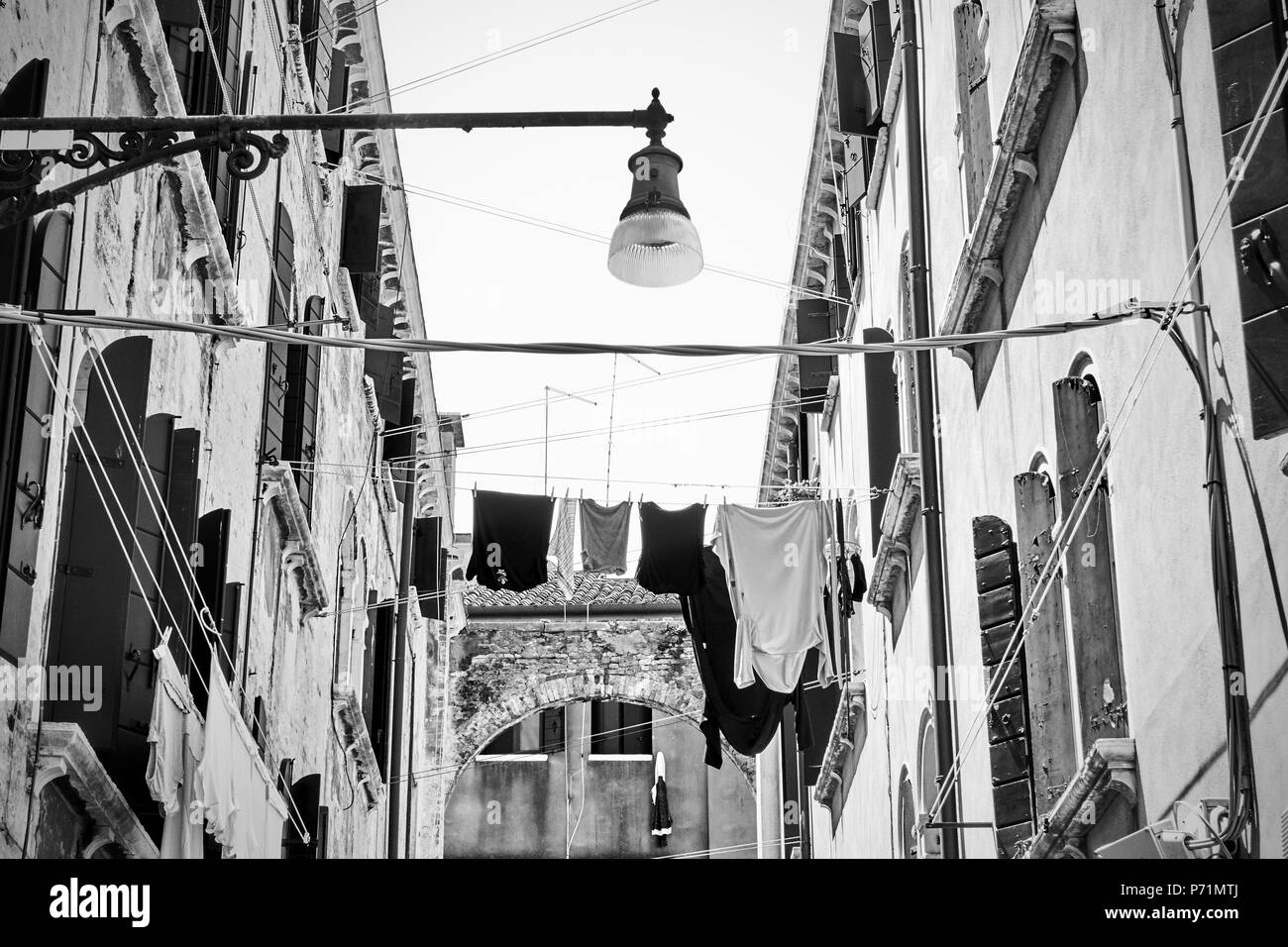 Venetian street with drying clothes, Venice, Italy - Stock Image