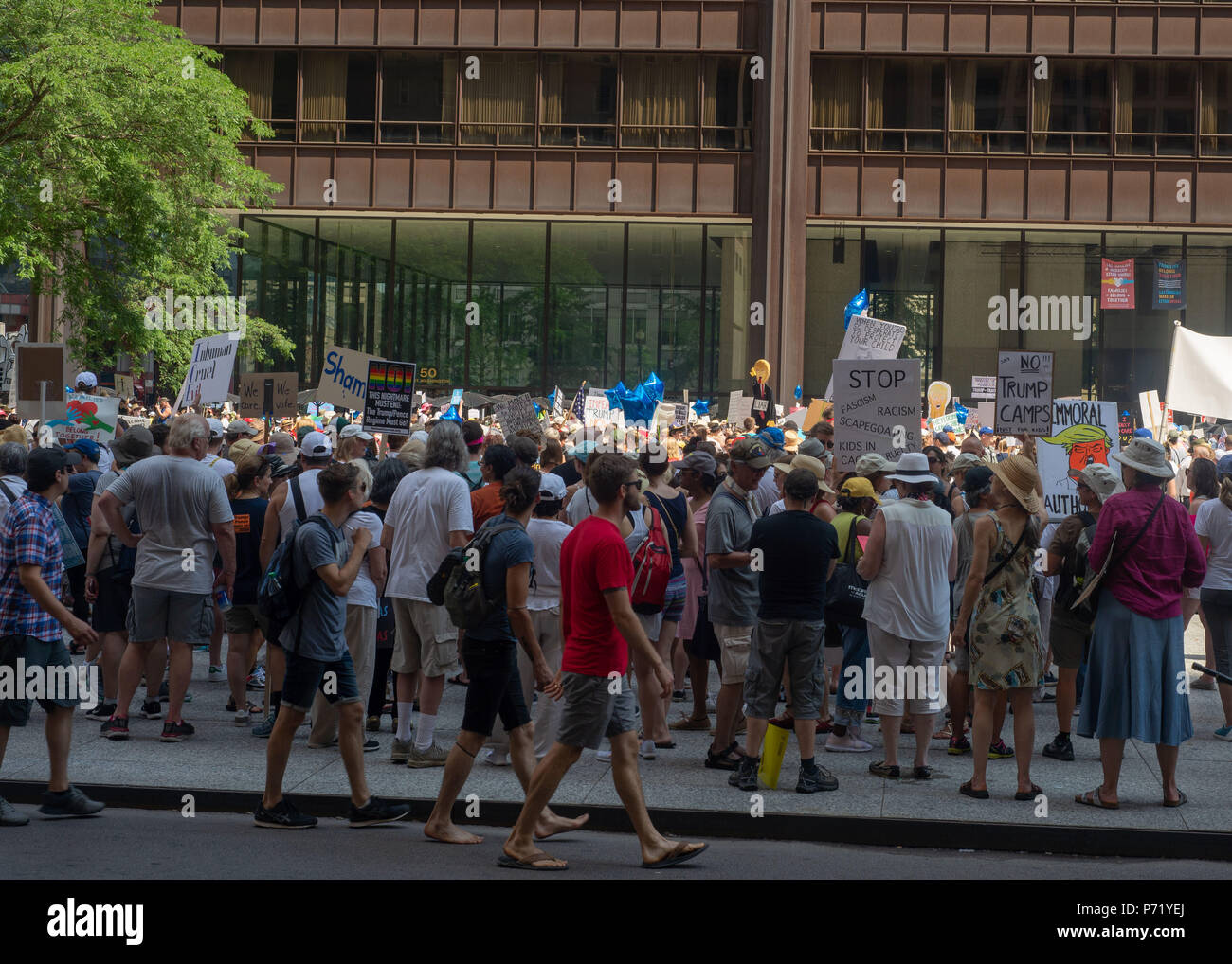 Signs and Crowd at Families Belong Together - Chicago March, jUNE 30, 2018, Richard J Daley Center, Chicago, IL - Stock Image