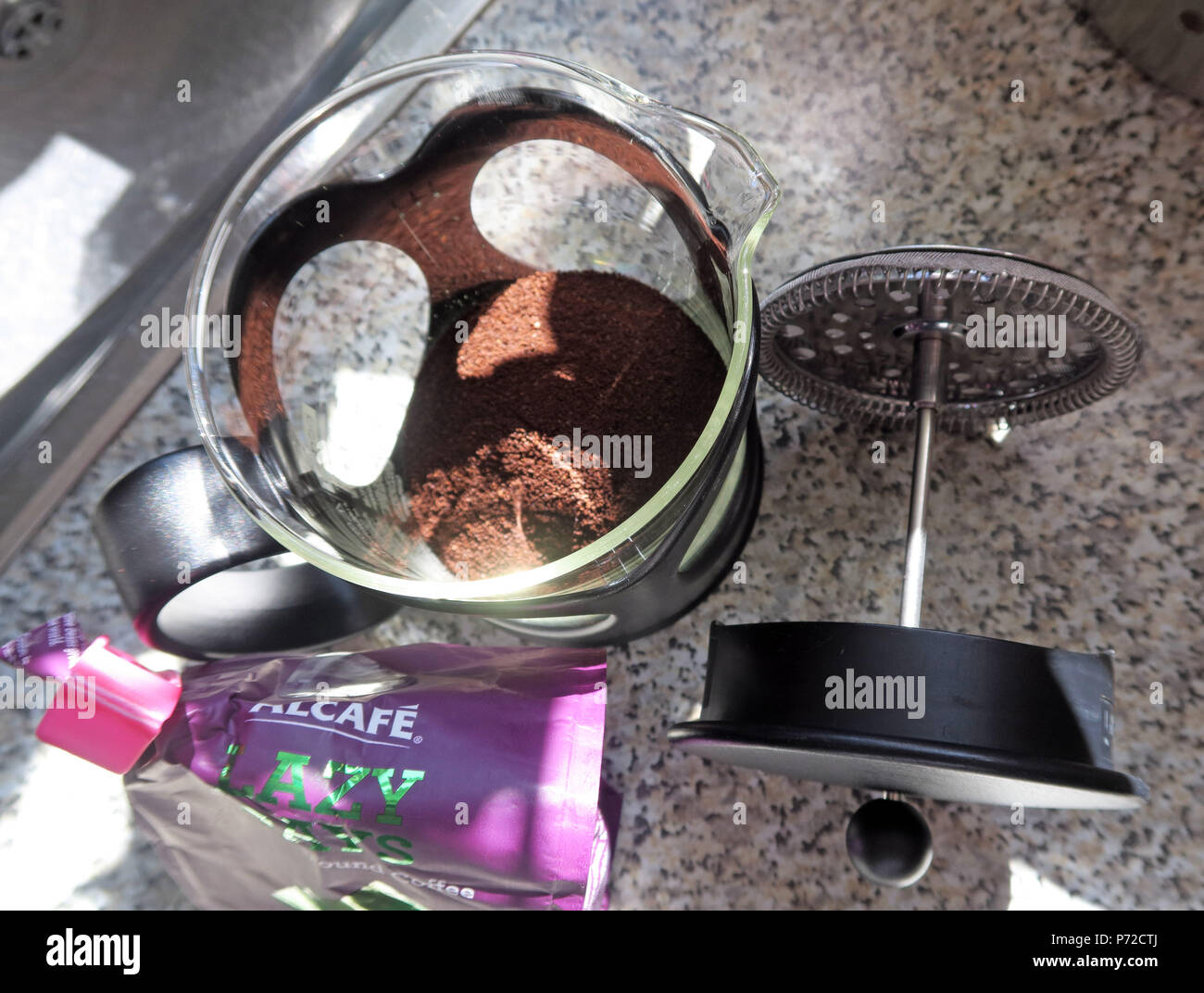 Preparing coffee, using a cafetiere at home, cafetiere coffee Stock Photo