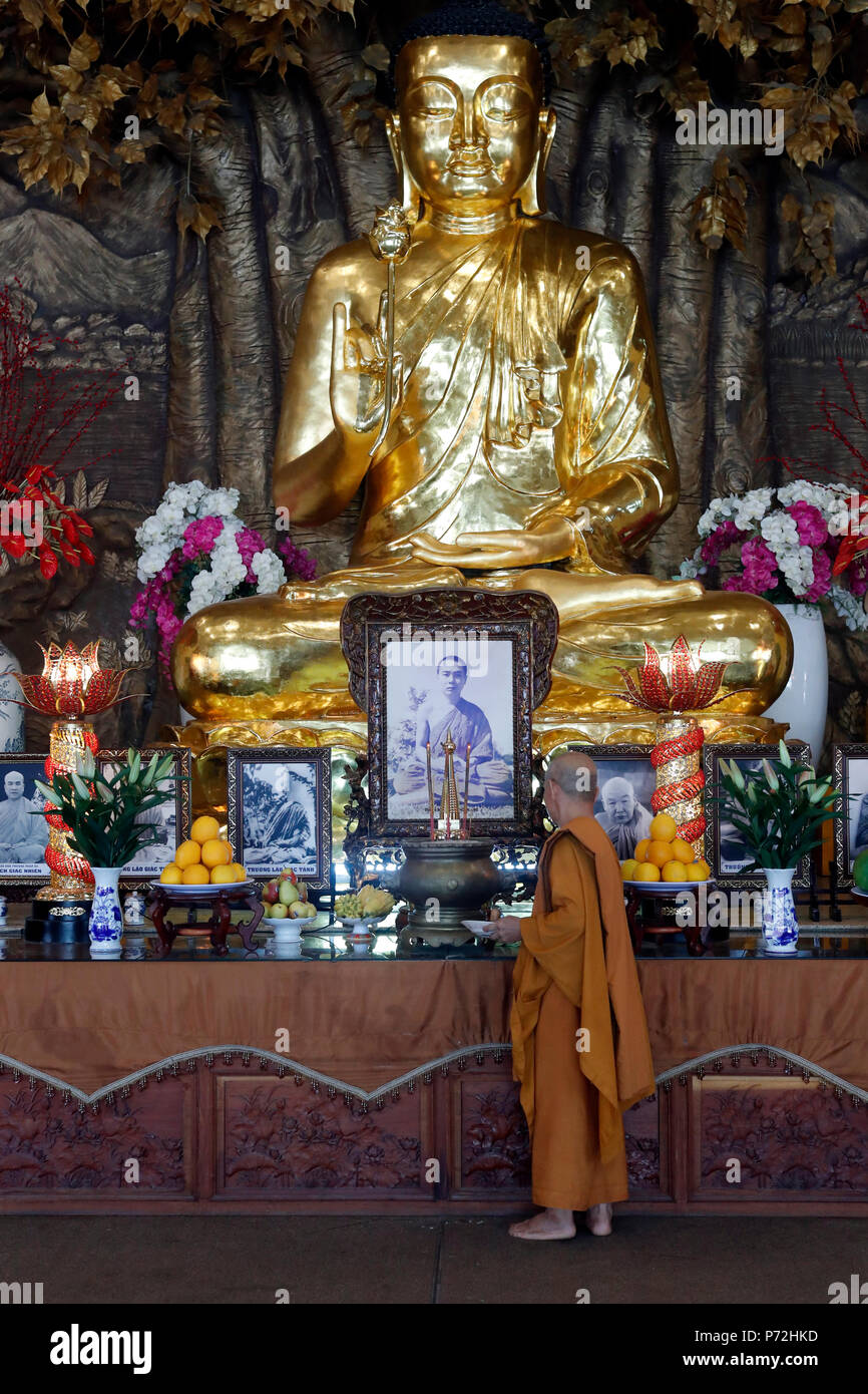 Golden Buddha With Lotus Flower And Buddhist Monk Minh Dang Quang