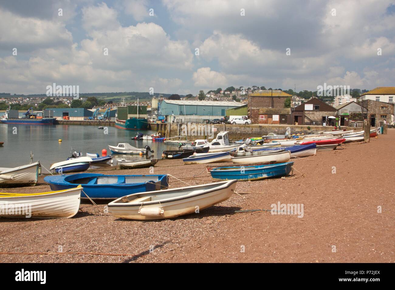 A view of Teignmouth back beach in the summer with fishing boats on the sand Stock Photo