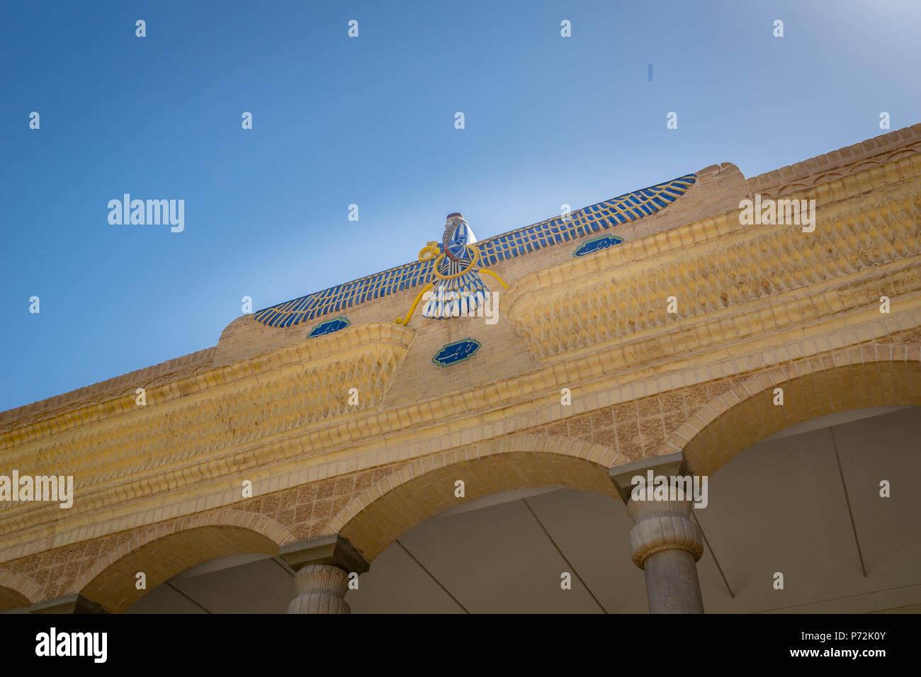 Yazd, Iran - June 2018: Faravahar mosaic symbol on Zoroastrian fire temple Atash Behram in old city of Yazd, Iran. - Stock Image