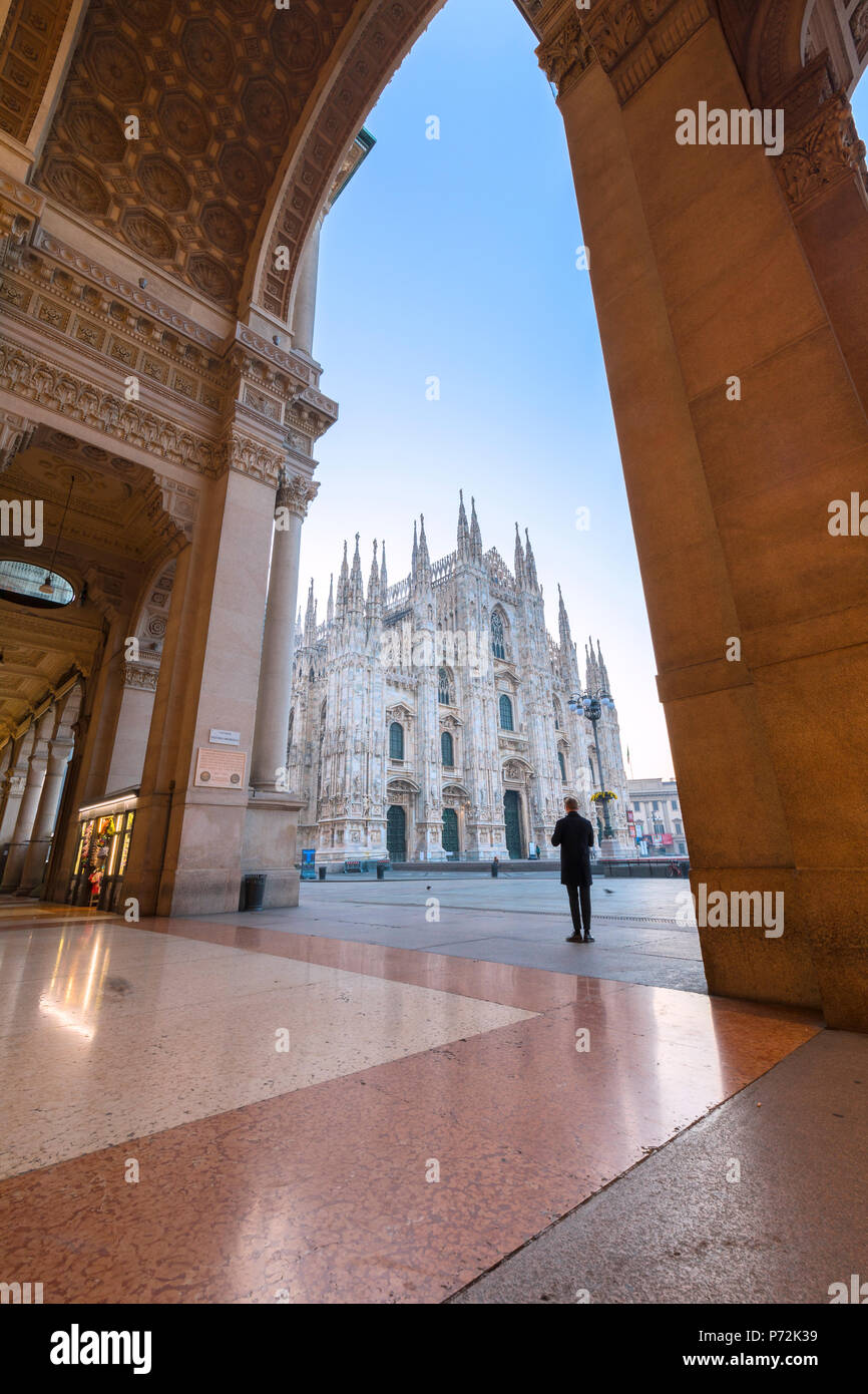 Man looks towards Milan Cathedral (Duomo) from Galleria Vittorio Emanuele II, Milan, Lombardy, Italy, Europe - Stock Image