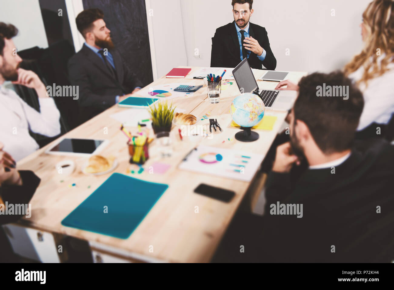 Team of businessmen work together in office. Concept of teamwork and partnership - Stock Image