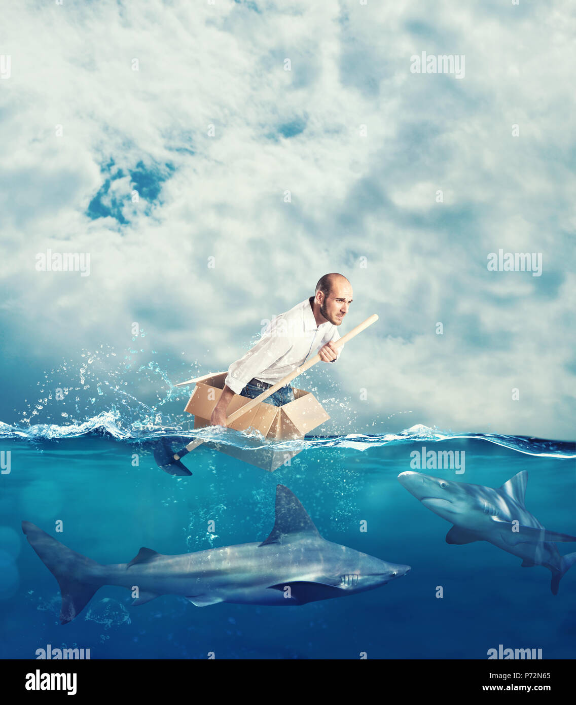 Escape from crisis concept with a businessman on a cardboard - Stock Image