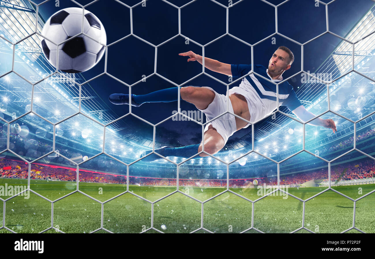 Soccer striker hits the ball with an jumping kick - Stock Image