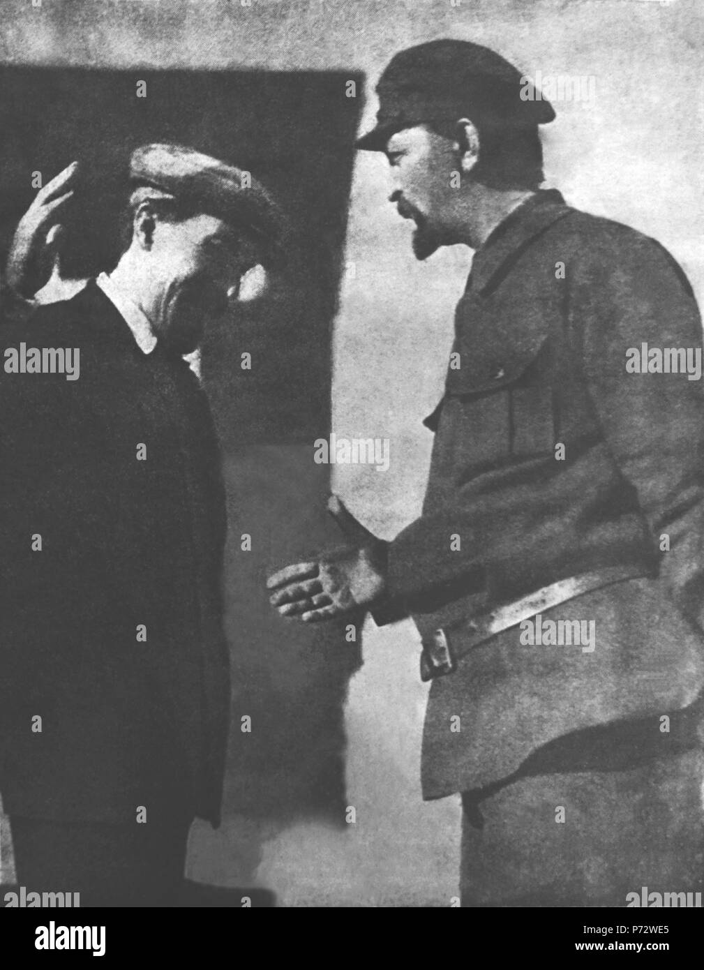 English: Alexei Rykov, Chairman of the Council of People's Commissars (Prime Minister) greets Felix Dzerzhinsky, Director of the OGPU. Context: From the early days of USSR, the State security agency (first called Cheka, then GPU/OGPU) became the important factor in conducting the government policies specifically directed to extinguish the resistance of class enemies/enemies of the people. Started as a temporary agency, GPU (later called NKVD and KGB) became monstrous organization operating the network of labor camps (GULAG), conducting prosecutions of entire ethnic and social groups and mass r - Stock Image