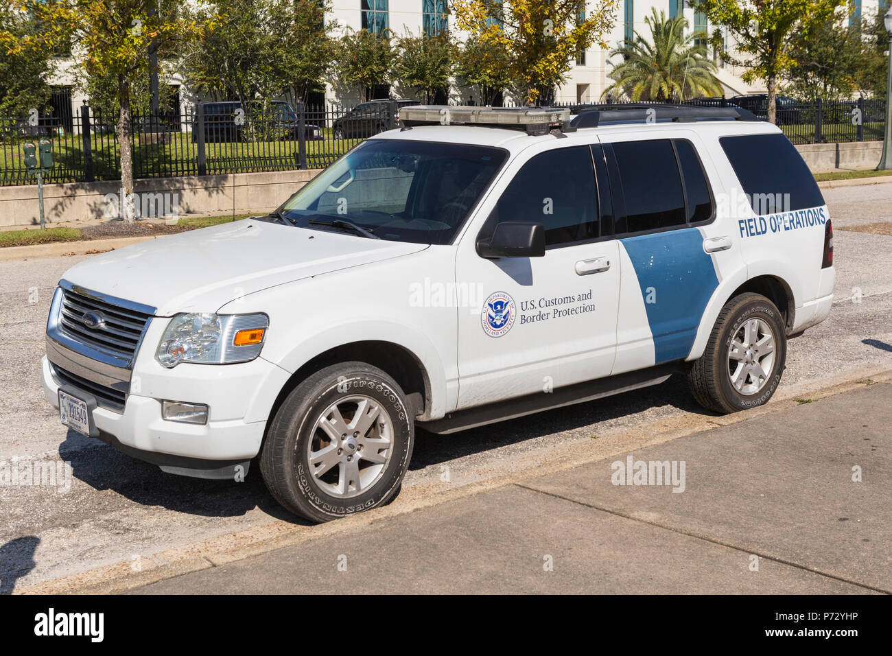 A U.S. Customs and Border Protection Field Operations vehicle parked in front of the Mobile Service Port office in Mobile, Alabama. - Stock Image