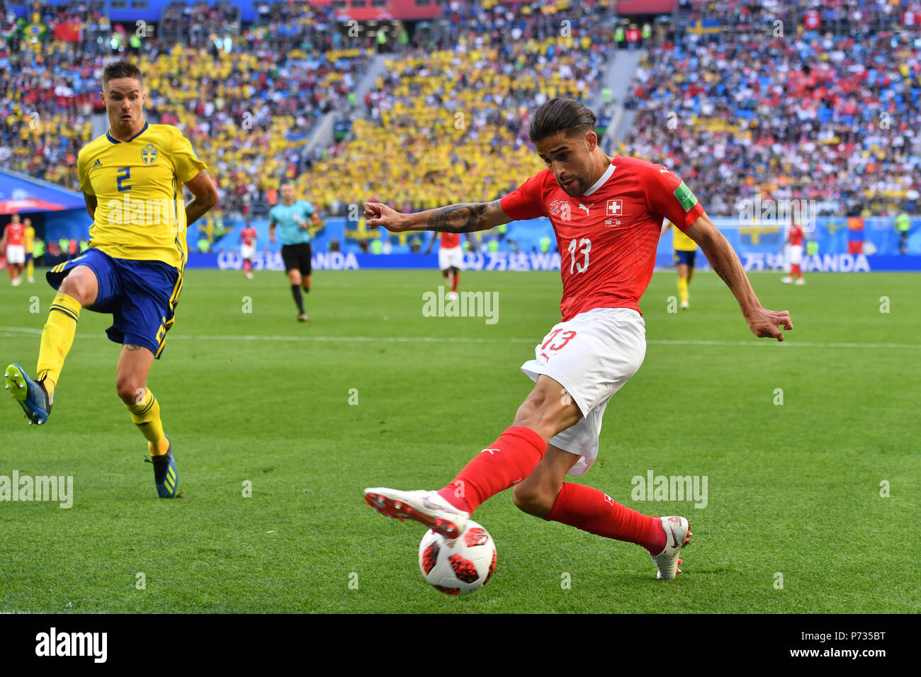 St. Petersburg, Russland. 03rd July, 2018. Ricardo RODRIGUEZ (SUI), action, duels versus Mikael FUNNY (SWE). Sweden (SWE) - Switzerland (SUI) 1-0, Round of 16, Round of 16, Game 55, on 07/03/2018 in Saint Petersburg, Arena Saint Petersburg. Football World Cup 2018 in Russia from 14.06. - 15.07.2018. | usage worldwide Credit: dpa/Alamy Live News Stock Photo
