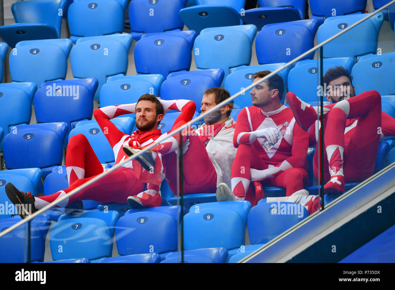St. Petersburg, Russland. 03rd July, 2018. swiss fans, football fans, disappointment, frustrated, disappointed, frustratedriert, dejected, Sweden (SWE) - Switzerland (SUI) 1-0, Round of 16, Round of 16, Game 55, on 07/03/2018 in Saint Petersburg, Arena Saint Petersburg. Football World Cup 2018 in Russia from 14.06. - 15.07.2018. | usage worldwide Credit: dpa/Alamy Live News Stock Photo