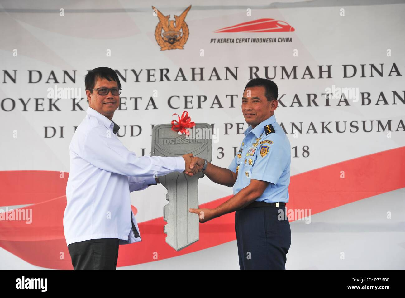 (180704) -- JAKARTA, July 4, 2018 (Xinhua) -- KCIC President Director Chandra Dwiputra (L) and Indonesian Air Force Chief of Staff Marshall Yuyu Sutisna attend the handover ceremony in Halim Perdanakusumah air base in eastern Jakarta, Indonesia, July 3, 2018. China-Indonesia joint firm carrying out the Jakarta-Bandung High-Speed Railway project, KCIC, handed over on Tuesday a housing cluster to compensate houses and land of Indonesian air force personnel which were used by the project. A total of 408 houses located in five zones were built by KCIC in the air force compound, comprised of houses - Stock Image