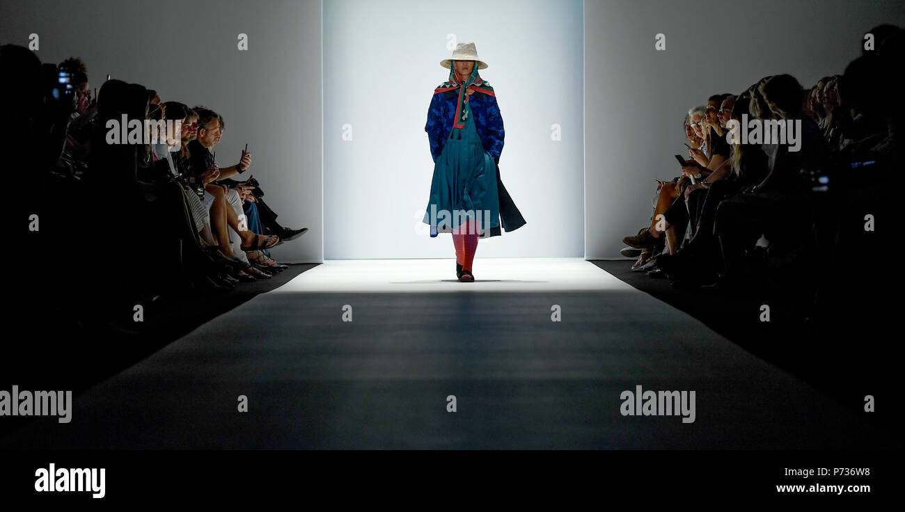 Berlin, Germany. 03rd July, 2018. Models present sustainable fashion at the Greenshowroom fashion show during the Berlin Fashion Week, which runs until 07 July. Credit: Britta Pedersen/dpa-Zentralbild/dpa/Alamy Live News - Stock Image