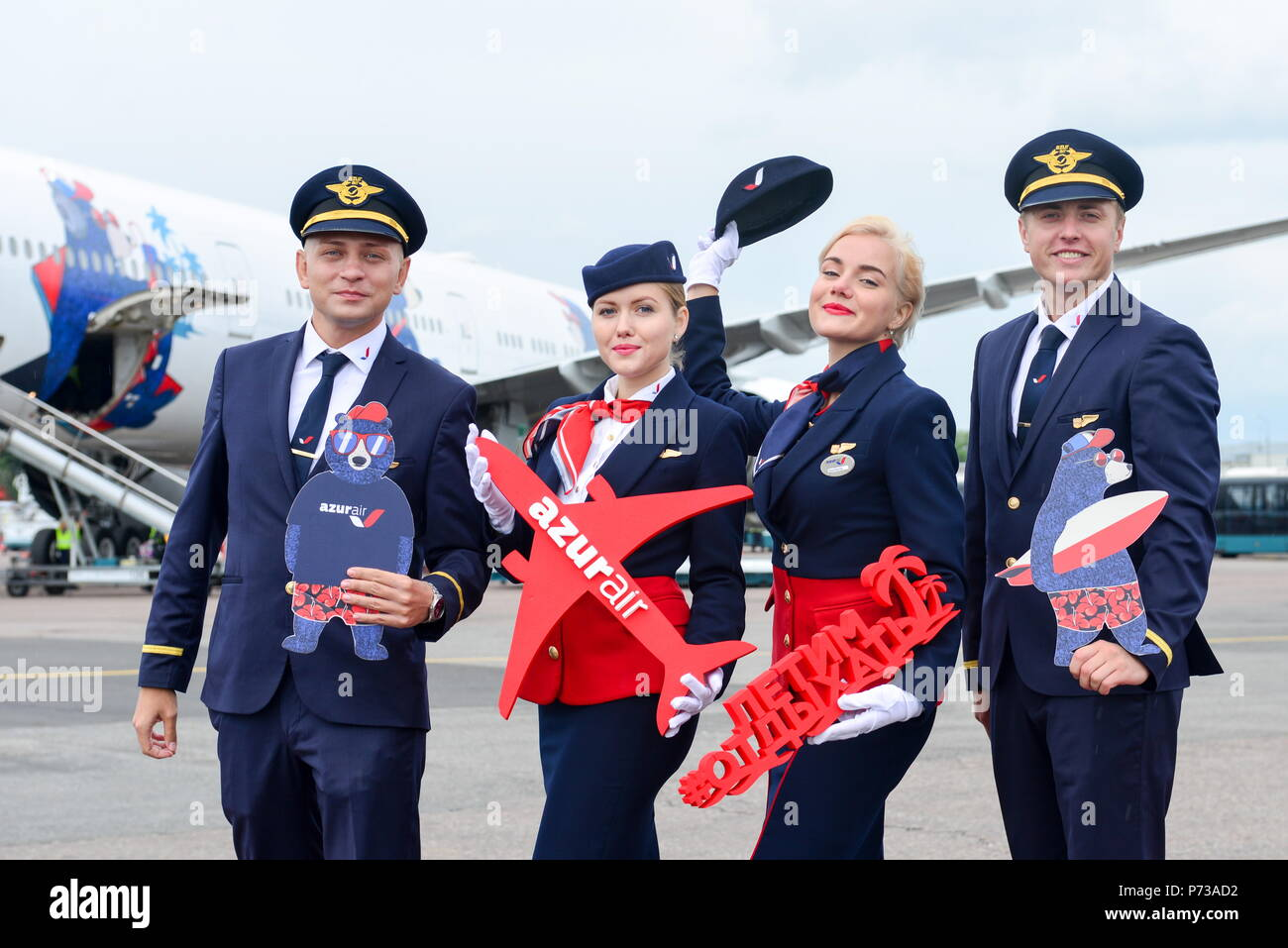 Moscow Region, Russia. 04th July, 2018. MOSCOW REGION, RUSSIA - JULY 4, 2018: Crewmembers of Azur Air's Boeing 777-300ER long-range wide-body jet airliner pose at Domodedovo International Airport. Marina Lystseva/TASS Credit: ITAR-TASS News Agency/Alamy Live News - Stock Image
