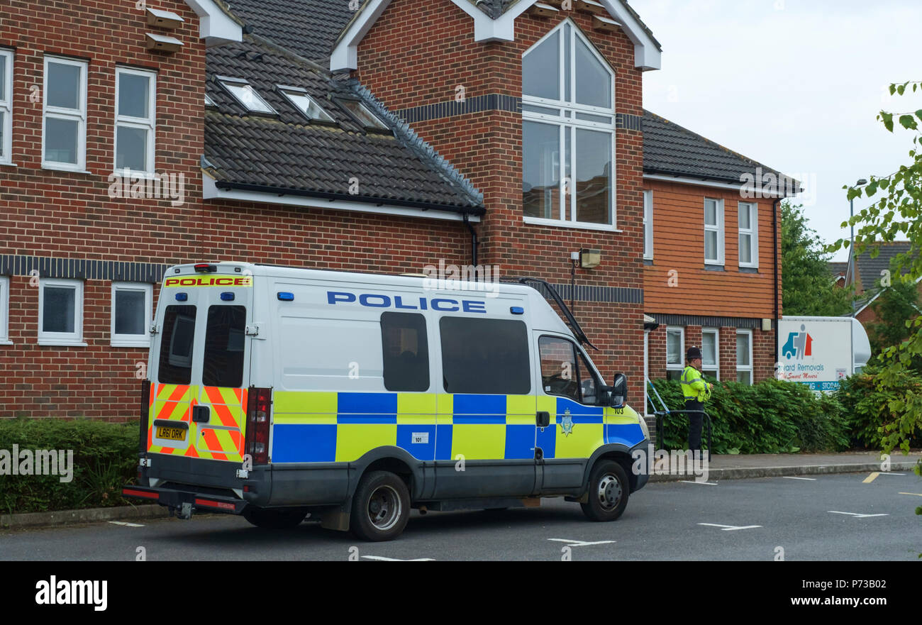 Amesbury, Wiltshire, England. 4th July 2018. After a man and woman collapsed in Amesbury from what appeared to be a drugs issue, the police have cordoned off their home and the local Baptist church. The couples collapse, the Police cordon and the proximity to the alleged poisoning of the Skripals in Salisbury has led to conjecture that the two may be conected. Picture shows the local baptist church with police guard and perimeter tape. ©JMF News / Alamy Live News Stock Photo