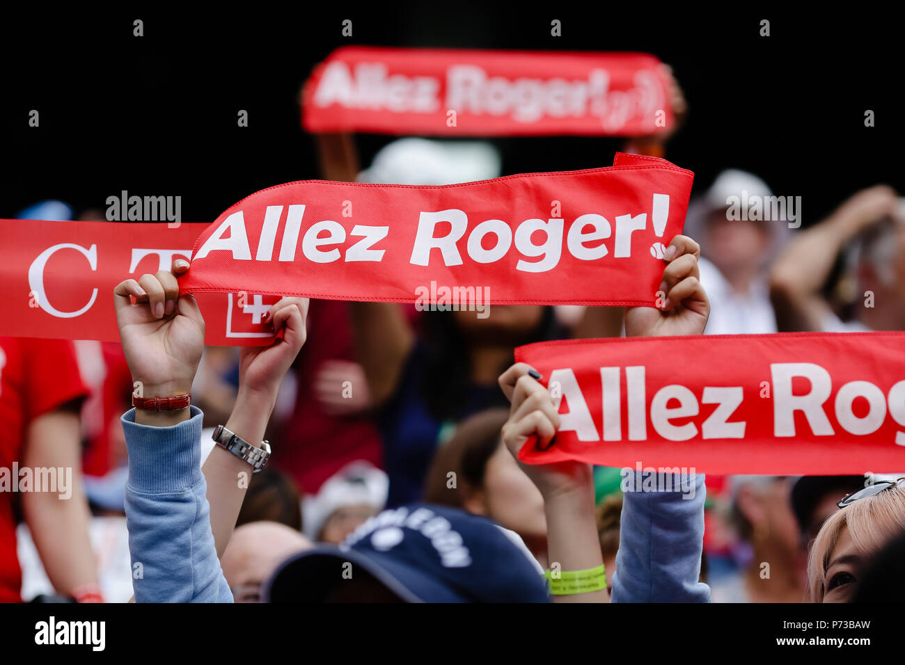 London, UK, 4th July 2018: Fans from defending champion Roger Federer cheer at day 3 at the Wimbledon Tennis Championships 2018 at the All England Lawn Tennis and Croquet Club in London. Credit: Frank Molter/Alamy Live news Stock Photo