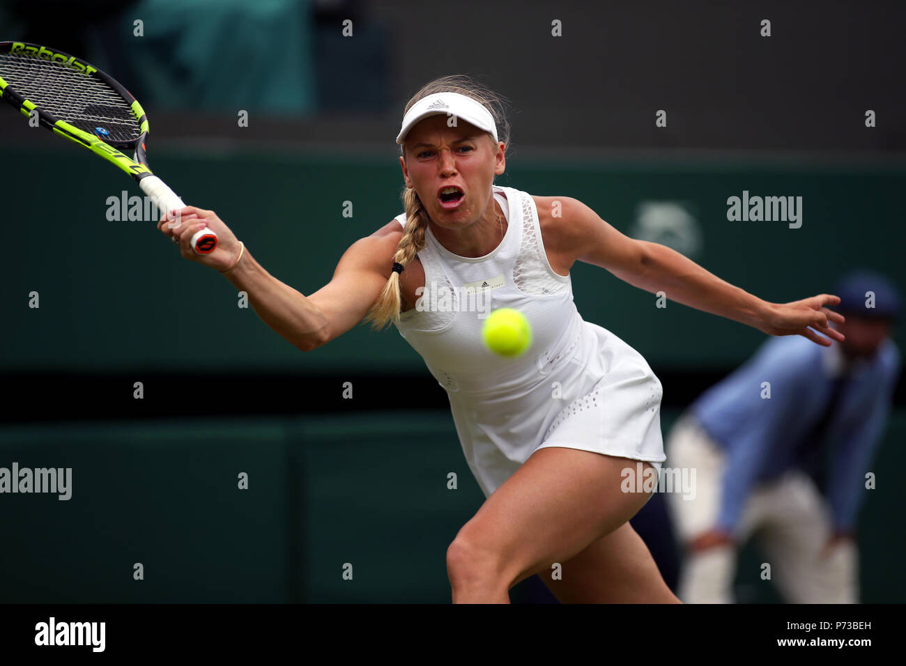 London, England - July 4th, 2018.  Wimbledon Tennis:  Number 2 seed Caroline Wozniacki of Denmark during her match against Ekaterina Makarova in the second round at Wimbledon today. Credit: Adam Stoltman/Alamy Live News Stock Photo
