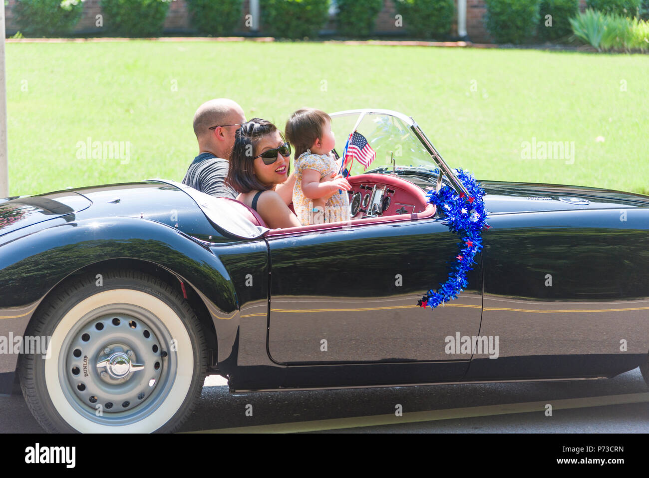 Germmantown, USA. July 4,2018. Germmantown, TN USA.  Neighborhood Parade.   2018. Enjoying the Fourth of July.  Independence Day USA. Families and friends enjoy the celebration with the colors, convertibles and cool breezes.  Temp in the nineties (35c) Credit: Gary Culley/Alamy Live News - Stock Image
