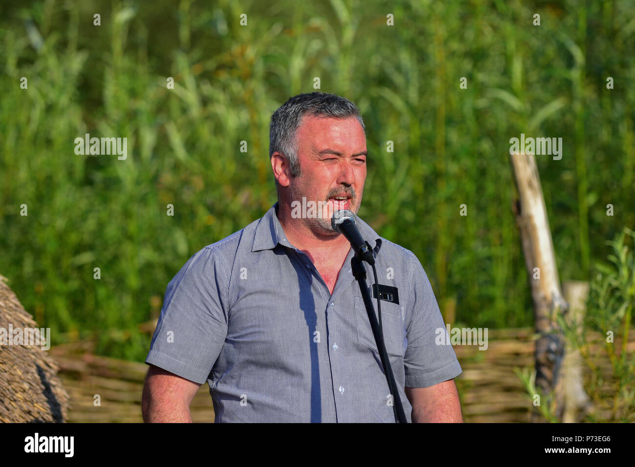 County Tyrone, UK. 4th July, 2018. Local Save our Sperrins Activist Sean Tracey speaks to gathered members of  Activists groups and community members fighting against the proposed destruction of the Sperrin Mountains in County Tyrone.  County Tyrone: UK:4th July 2018 Credit: Mark Winter/Alamy Live News - Stock Image