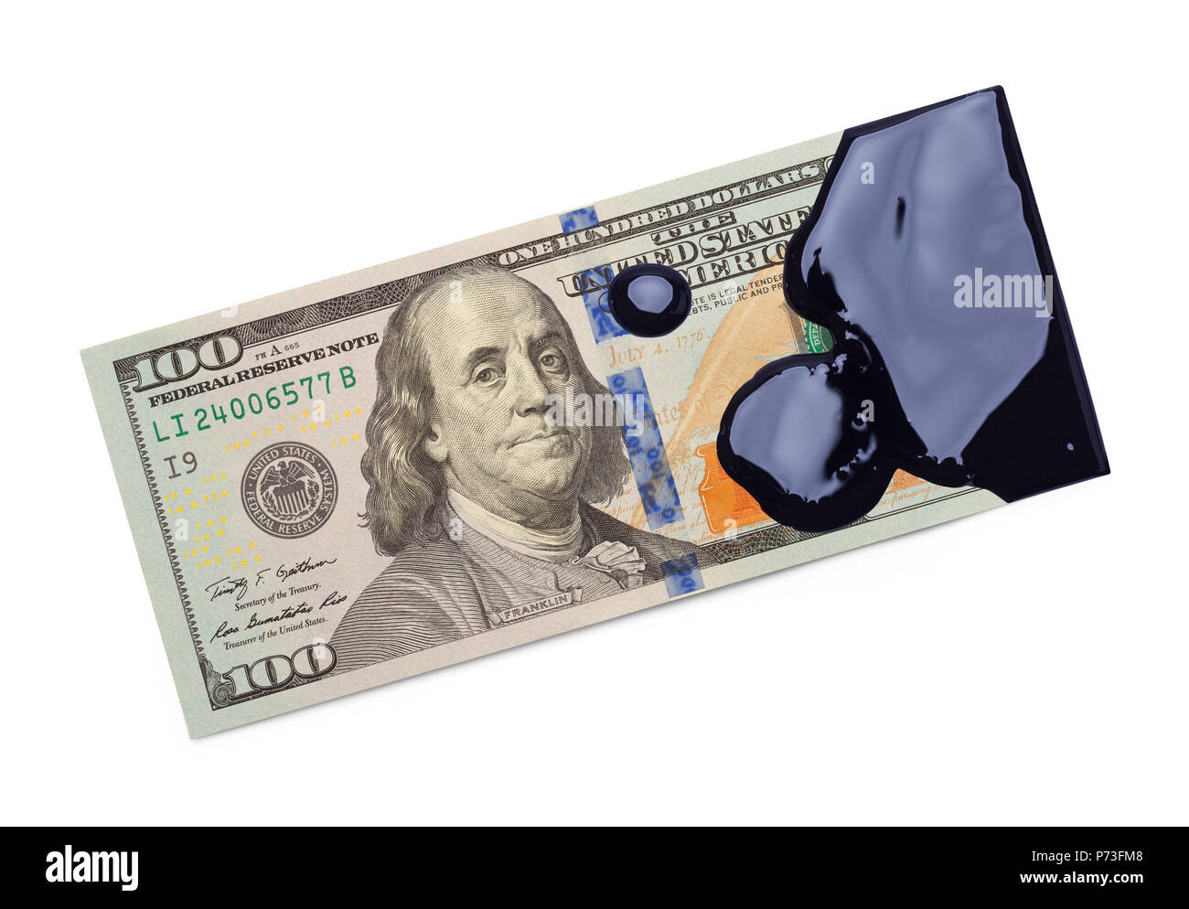 One Hundred Dollar Bill Covered in Black Oil Isolated on a White Background. - Stock Image