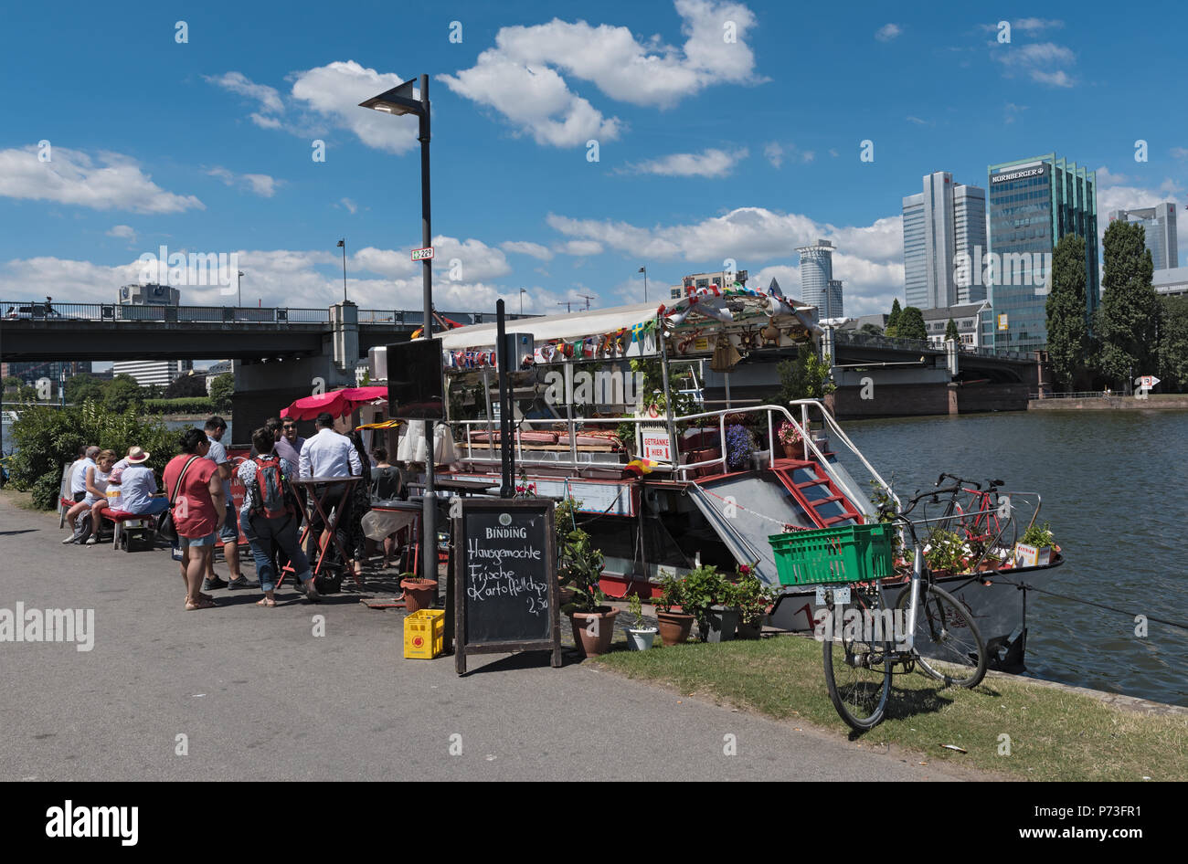 customers in front of the Floating Food stall on the Main River, Frankfurt, Germany - Stock Image