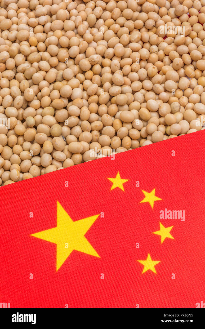 Chinese flag with dried soybeans - metaphor for China-US trade war and Chinese tariffs on US soybean imports. - Stock Image