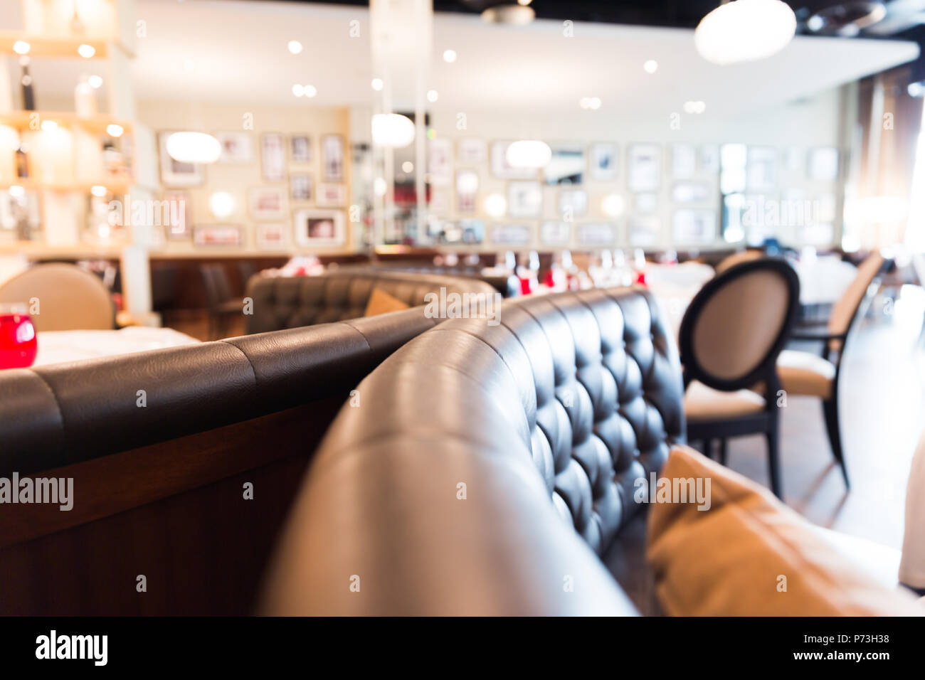 Restaurant Rounded Leather Coach with Blurred Background - Stock Image