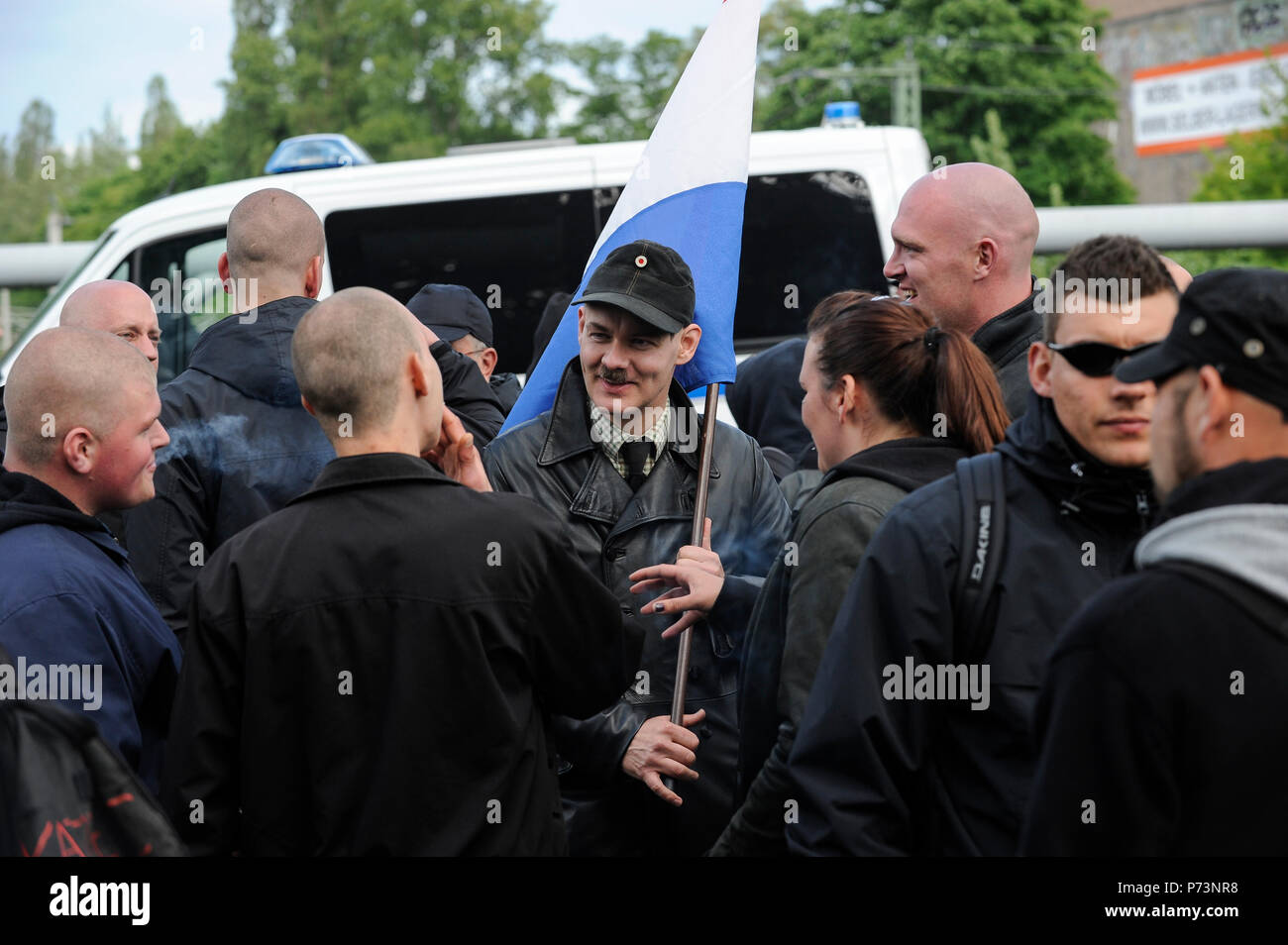 Germany, rally of Nazi and right extremists groups in hamburg, Neo Nazi activist with Adolf Hitler moustache Stock Photo