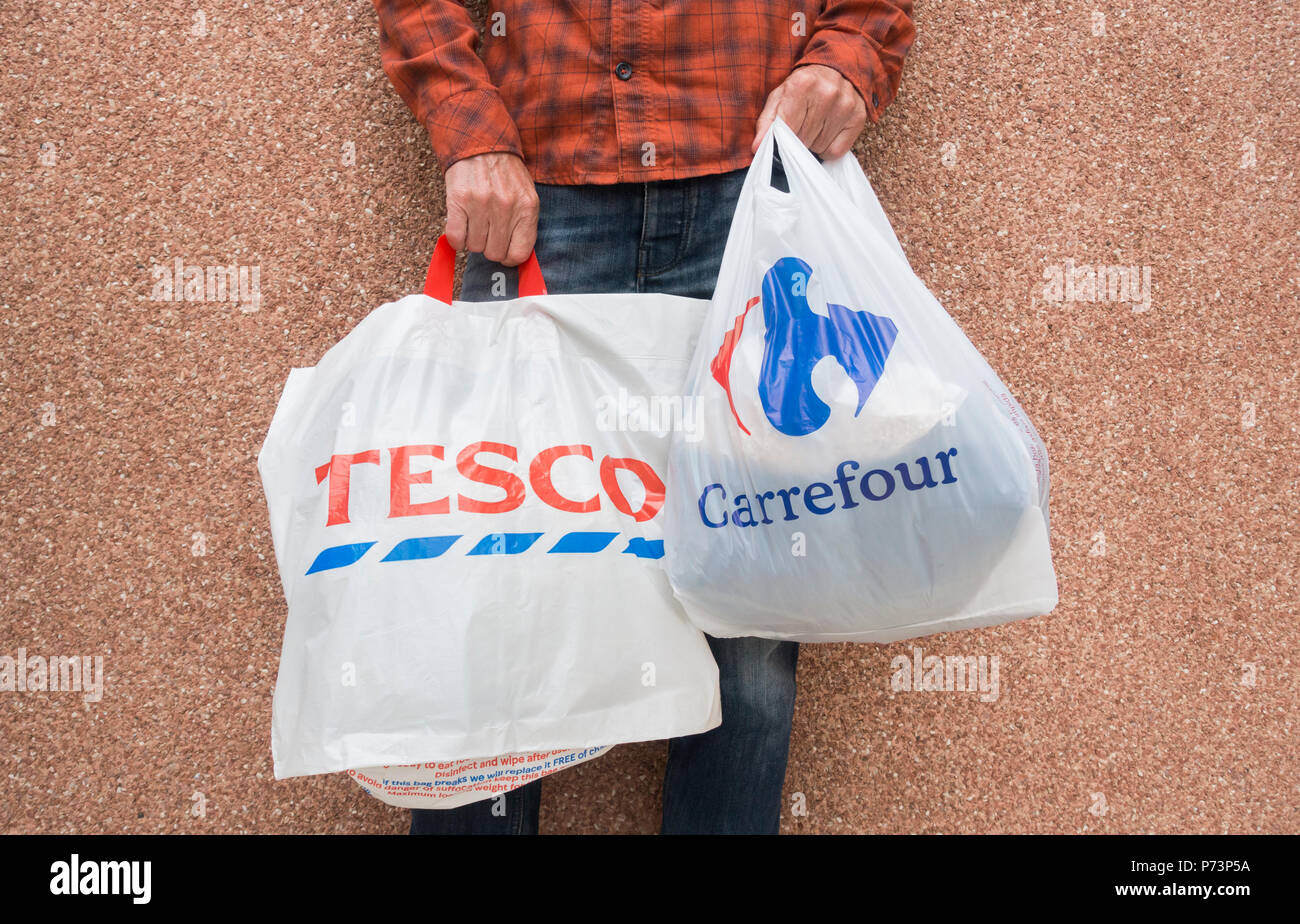 Tesco and Carrefour supermaket plastic bags - Stock Image