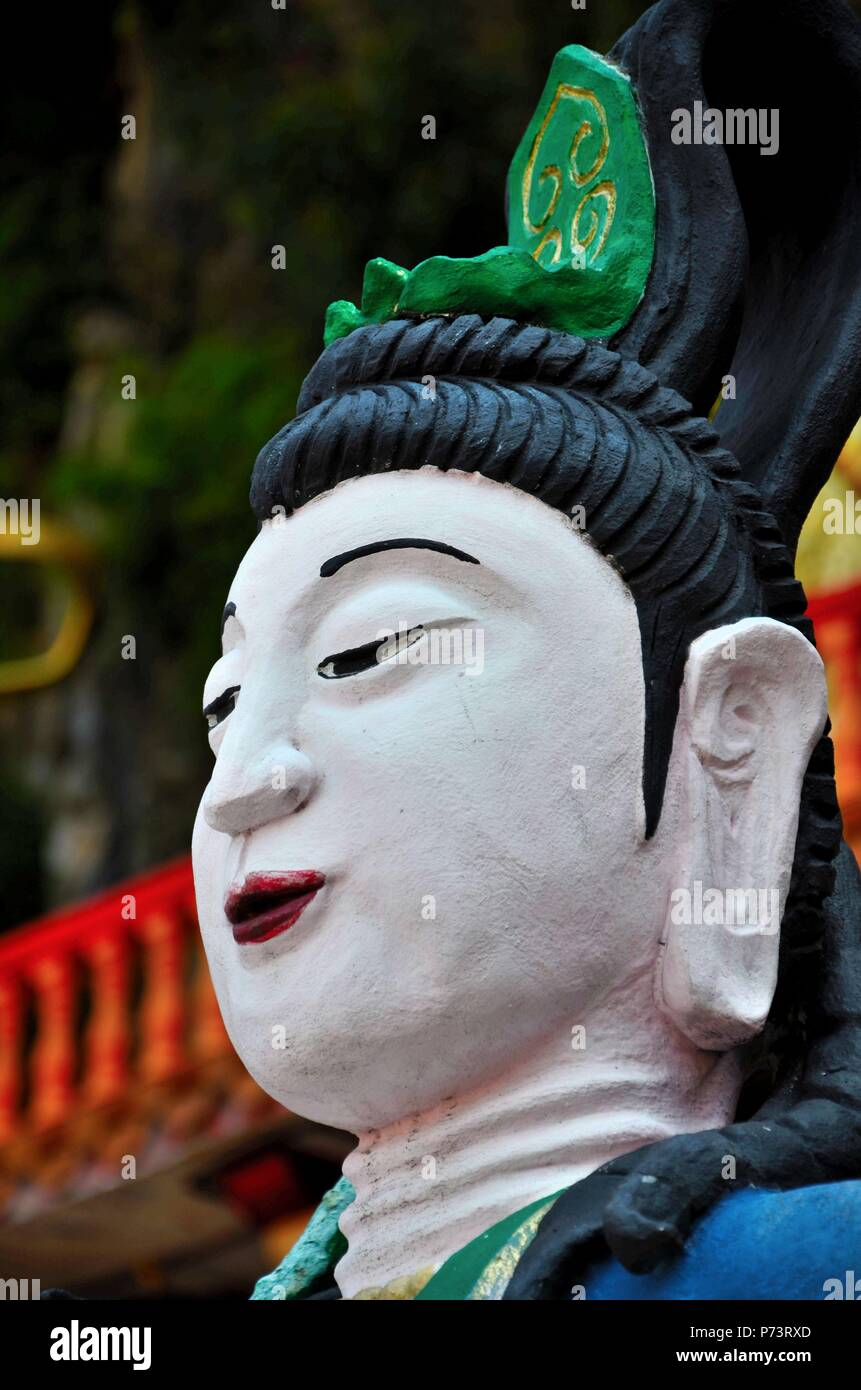 Chinese goddess face sculpture with green tiara at Ling Sen Tong Taoist temple Ipoh Malaysia - Stock Image