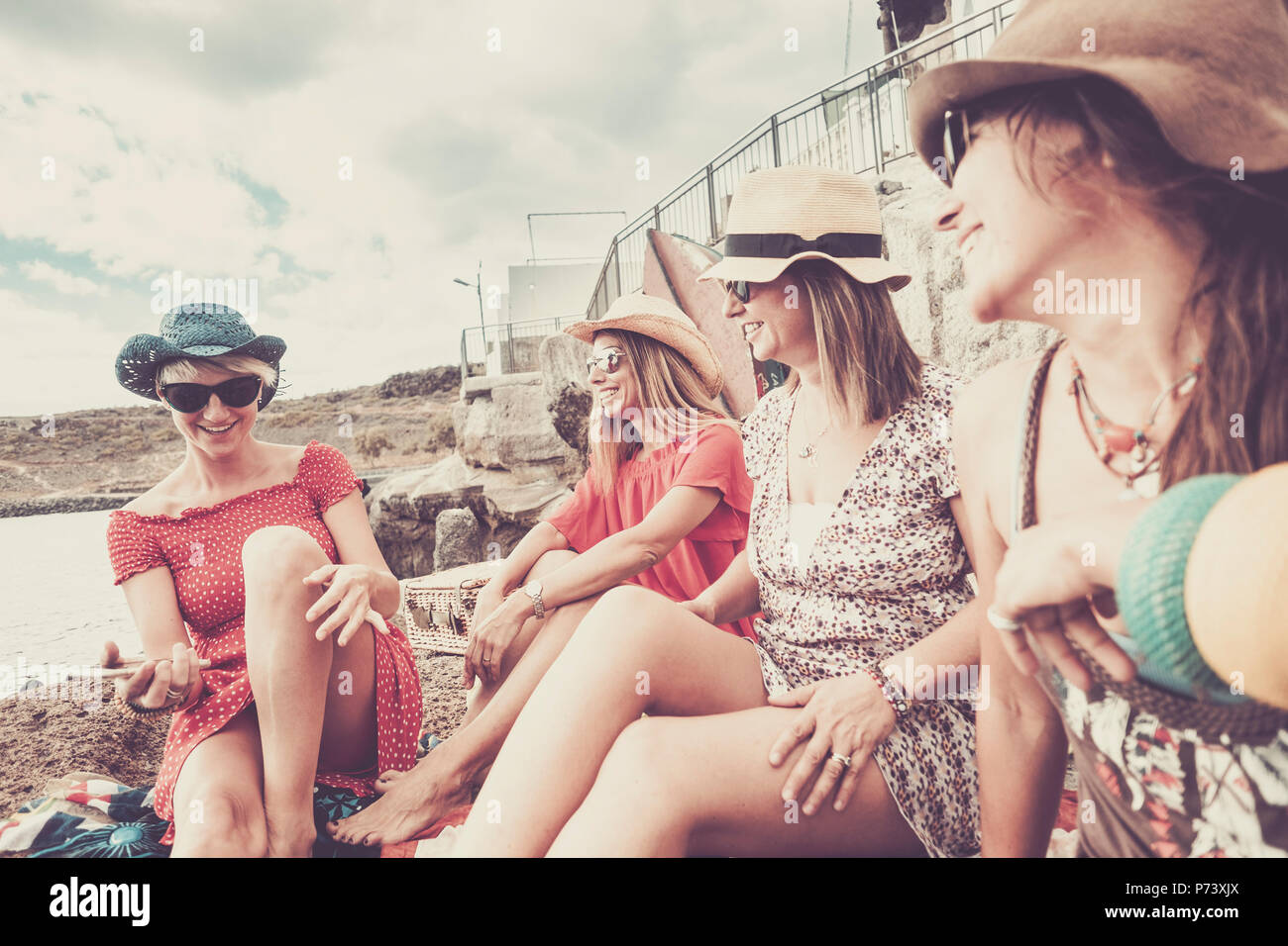 vintage style for group of females people stay together in friendship on vacation near the beach for summer leisure activiy. smiles and laughs for nbe - Stock Image