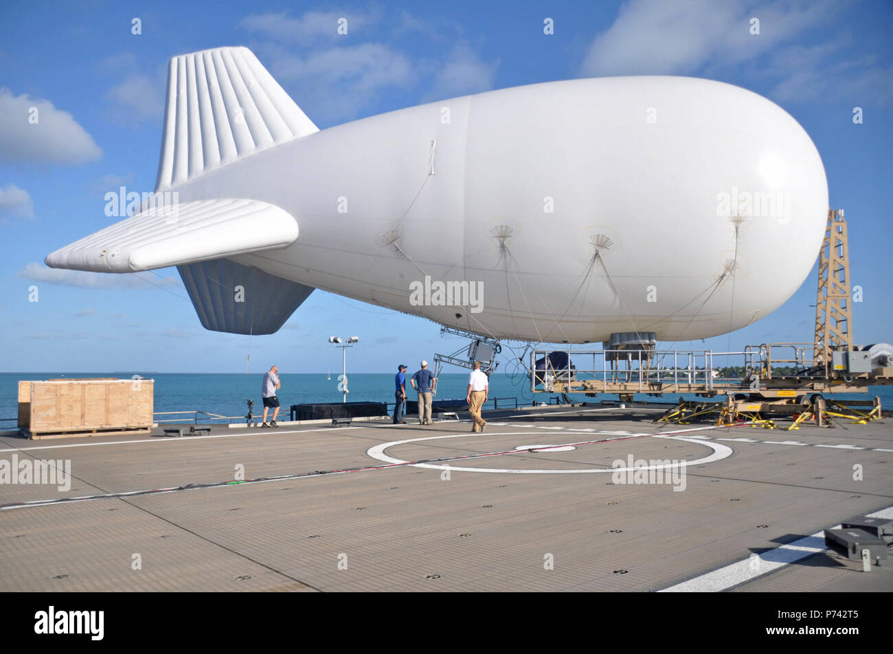 A TIF-25K tethered aerostat system is positioned on the high speed vessel Swift (HSV-2) at Naval Air Station Key West, Fla., April 23, 2013, before being tested at sea for future Operation Martillo missions. Martillo is a joint, interagency and multinational collaborative effort to deny transnational criminal organizations air and maritime access to the littoral regions of the Central American isthmus. (DoD - Stock Image