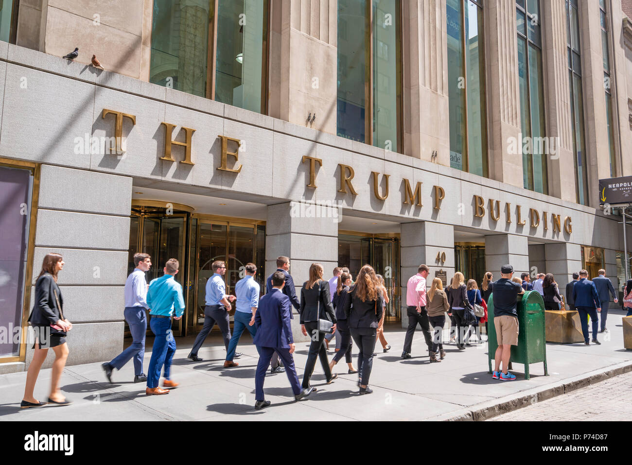 White collar workers outside the Trump Building at Wall Street Stock Photo