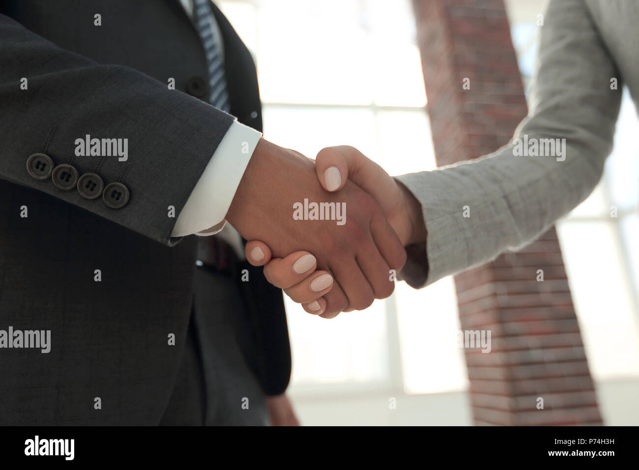 Business people shaking hands isolated on white background - Stock Image